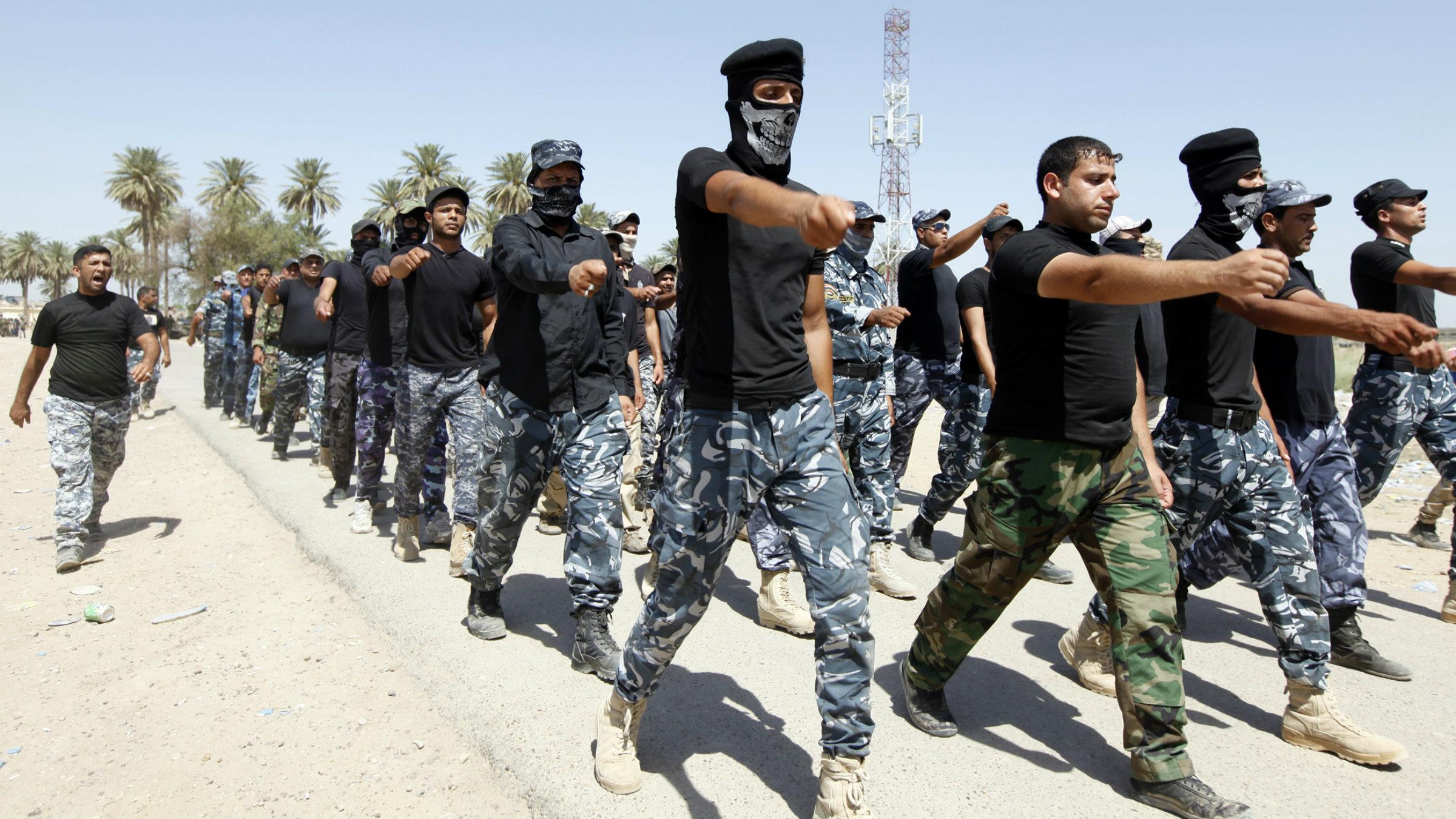 Shi'ite volunteers training in Baghdad on July 9, 2014.