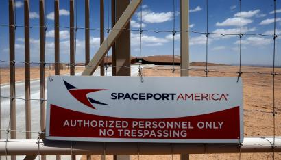 A view of the perimeter fence of Spaceport America near Truth or Consequences, New Mexico May 1, 2014. The world's first purpose-built commercial space base and soon-to-be site of the first space flights with Sir Richard Branson's Virgin Galactic is near the town of Truth or Consequences in New Mexico. The inaugural flight into suborbital space should happen later this year and the first astronauts, who have made reservations and paid $250,000 for the flight, should follow a month later. While it's not clear what the economic impact will be, many agree that Spaceport America should inject new energy into the town. Picture taken May 1, 2014. REUTERS/Lucy Nicholson (UNITED STATES - Tags: BUSINESS SOCIETY SCIENCE TECHNOLOGY) ATTENTION EDITORS: PICTURE 31 OF 40 FOR PACKAGE 'TRUTH OR CONSEQUENCES - SPACEPORT'. TO FIND ALL IMAGES SEARCH 'CONSEQUENCES LUCY' - RTR3OAQU