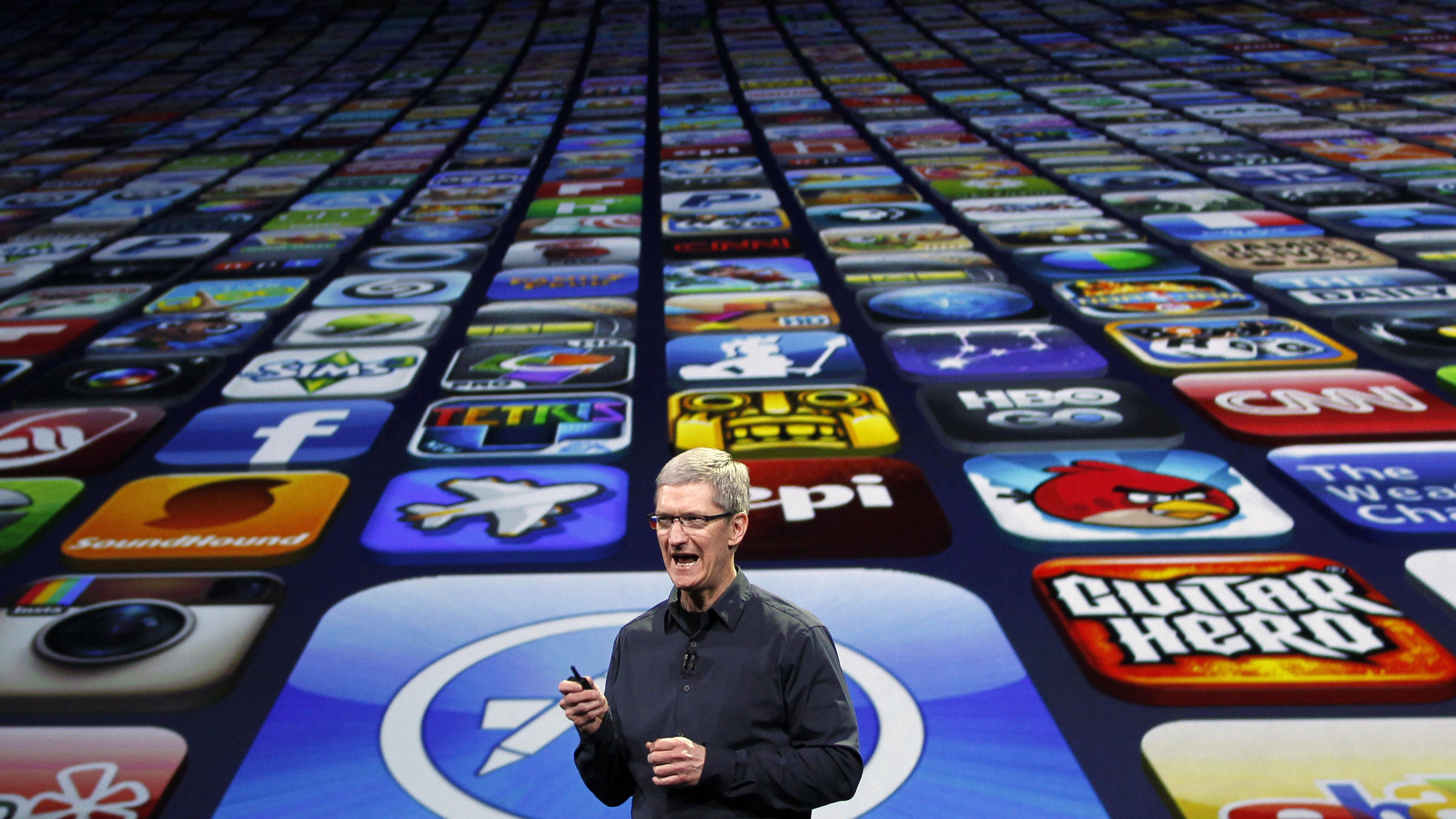 Apple CEO Tim Cook speaks about the number of Apps downloaded during an Apple event in San Francisco, California March 7, 2012. REUTERS/Robert Galbraith