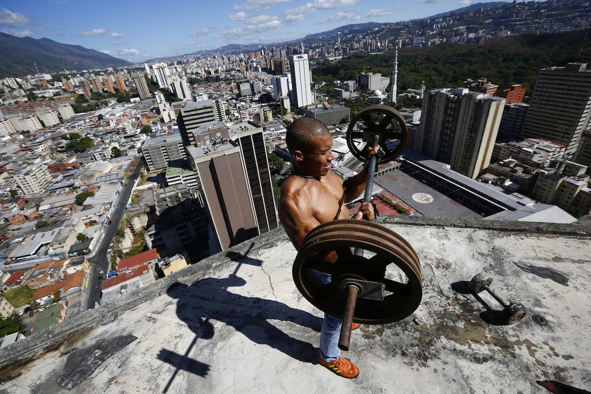 A resident lifts weights on the 28th floor of Torre Silva