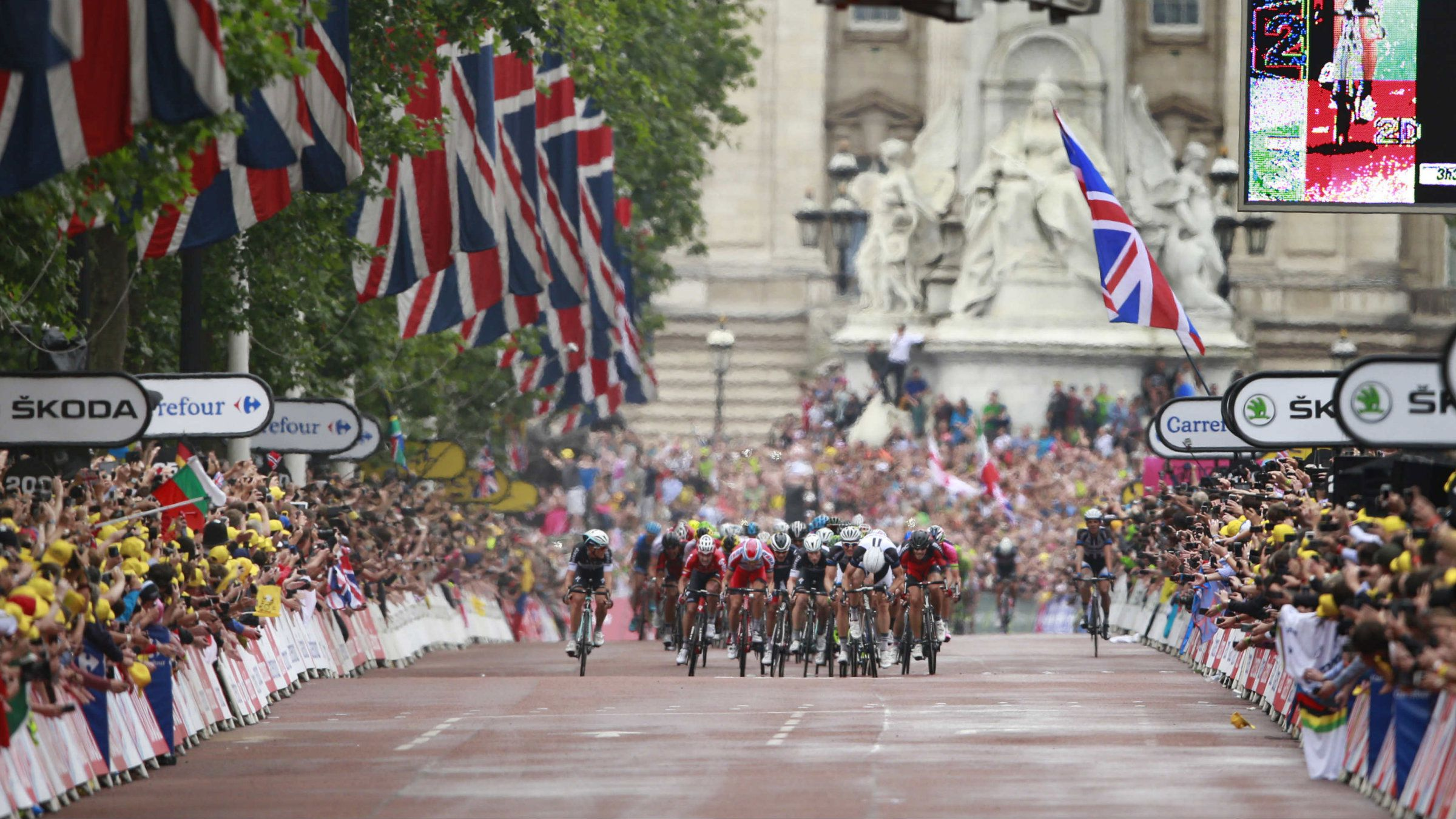 The pack with Stage winner Marcel Kittel of Germany sprints down The Mall as Buckingham Palace is seen in the rear during the third stage of the Tour de France cycling race over 155 kilometers (96.3 miles) with start in Cambridge and finish in London, England, Monday, July 7, 2014.