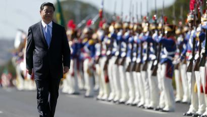 Xi Jinping walks in front of military.