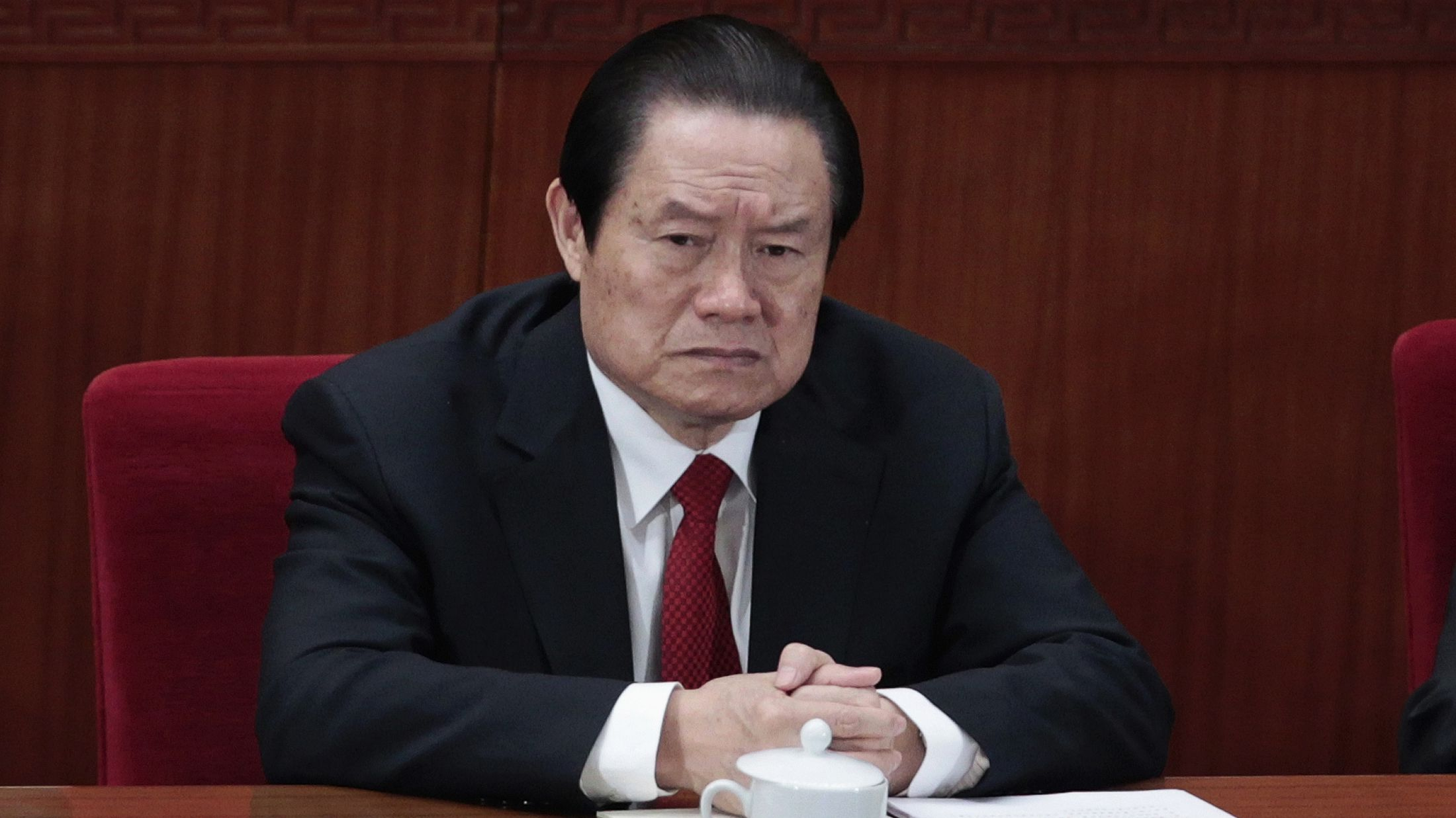 corruption detention purge xi jinping Former China's Politburo Standing Committee Member Zhou Yongkang attends the closing ceremony of the National People's Congress (NPC) at the Great Hall of the People in Beijing March 14, 2012. China's senior leadership has agreed to open a corruption investigation into Zhou, one of China's most powerful politicians in the past decade, stepping up its anti-graft campaign, the South China Morning Post reported on August 30, 2013. Picture taken March 14, 2012. REUTERS/Jason Lee
