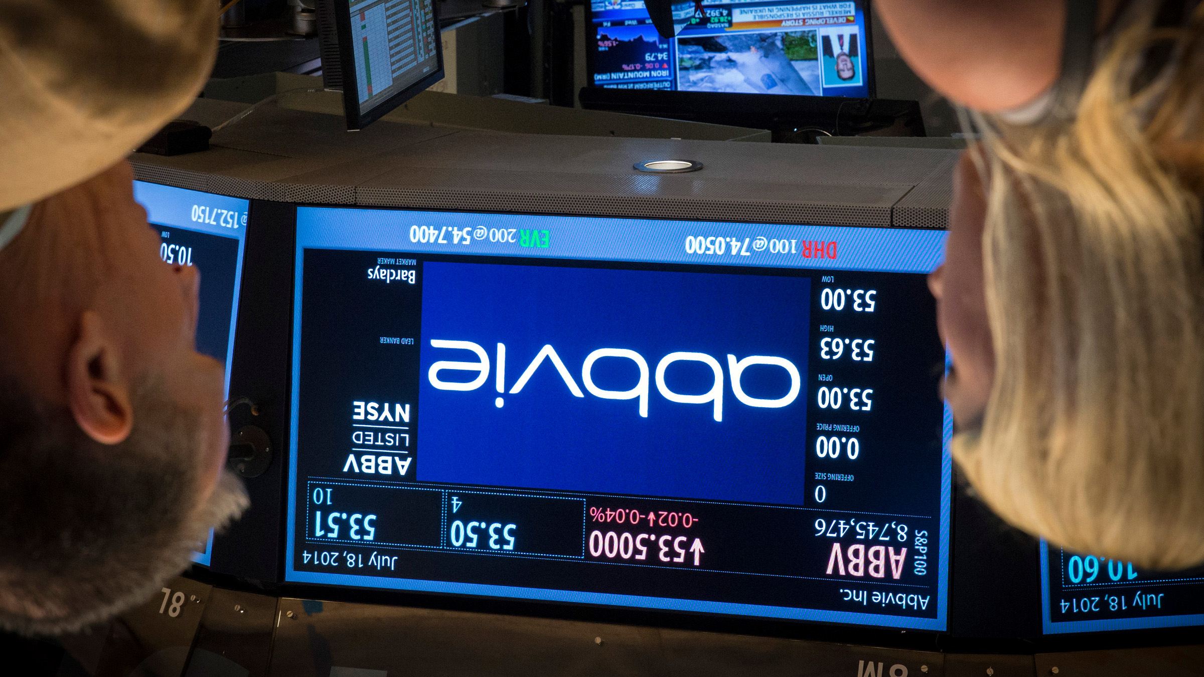 A screen displays the share price for pharmaceutical maker AbbVie on the floor of the New York Stock Exchange July 18, 2014. Shire said on July 18 that it had accepted an offer of 32 billion pounds ($54.7 billion) from AbbVie. The U.S. pharmaceutical company will pay 24.44 pounds in cash and 0.8960 of a new AbbVie share for each Shire share.