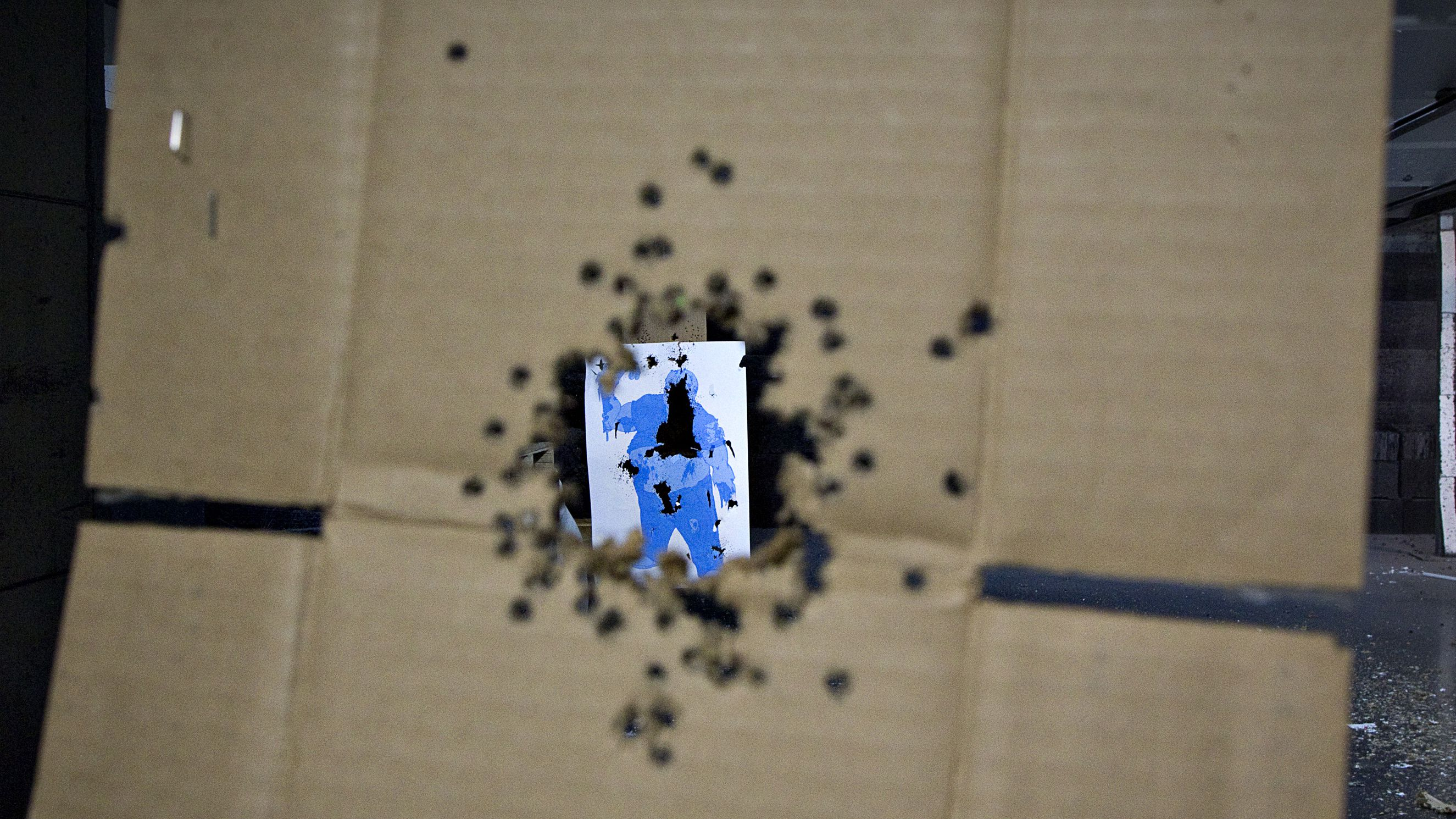nien year old girl shot killed shoot mohave arizona uzi automatic machine gun accidental death firing shooting range parents supervision law gun A target hit several times is seen through a piece of cardboard also peppered with bullet holes at the DVC Indoor Shooting Centre in Port Coquitlam, British Columbia March 22, 2013. The range has large membership though the general public is also welcome. REUTERS/Andy Clark