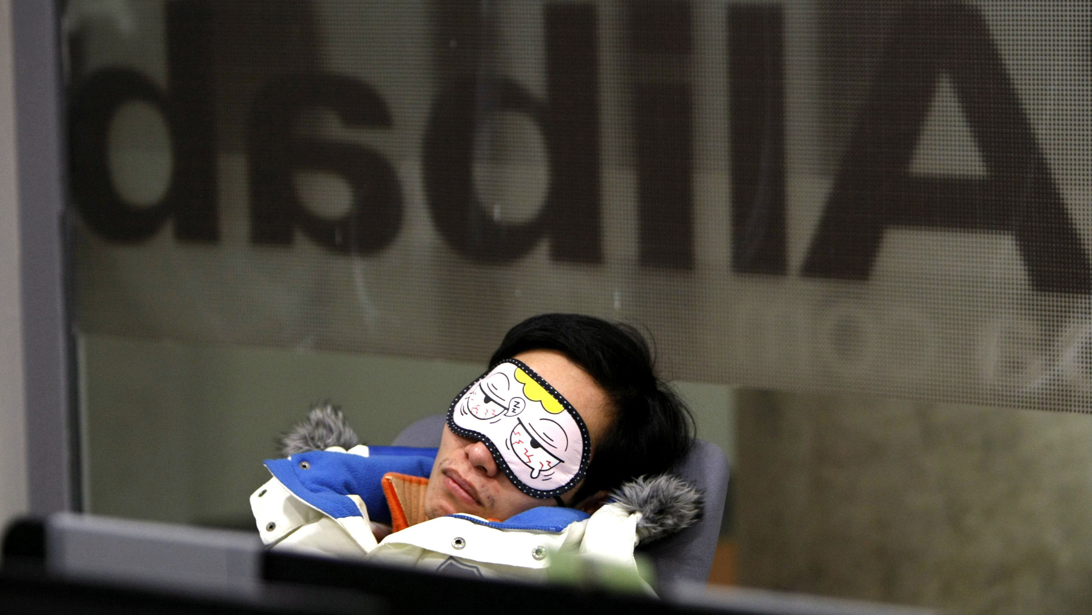 An employee takes a nap during a break inside the headquarters of Alibaba