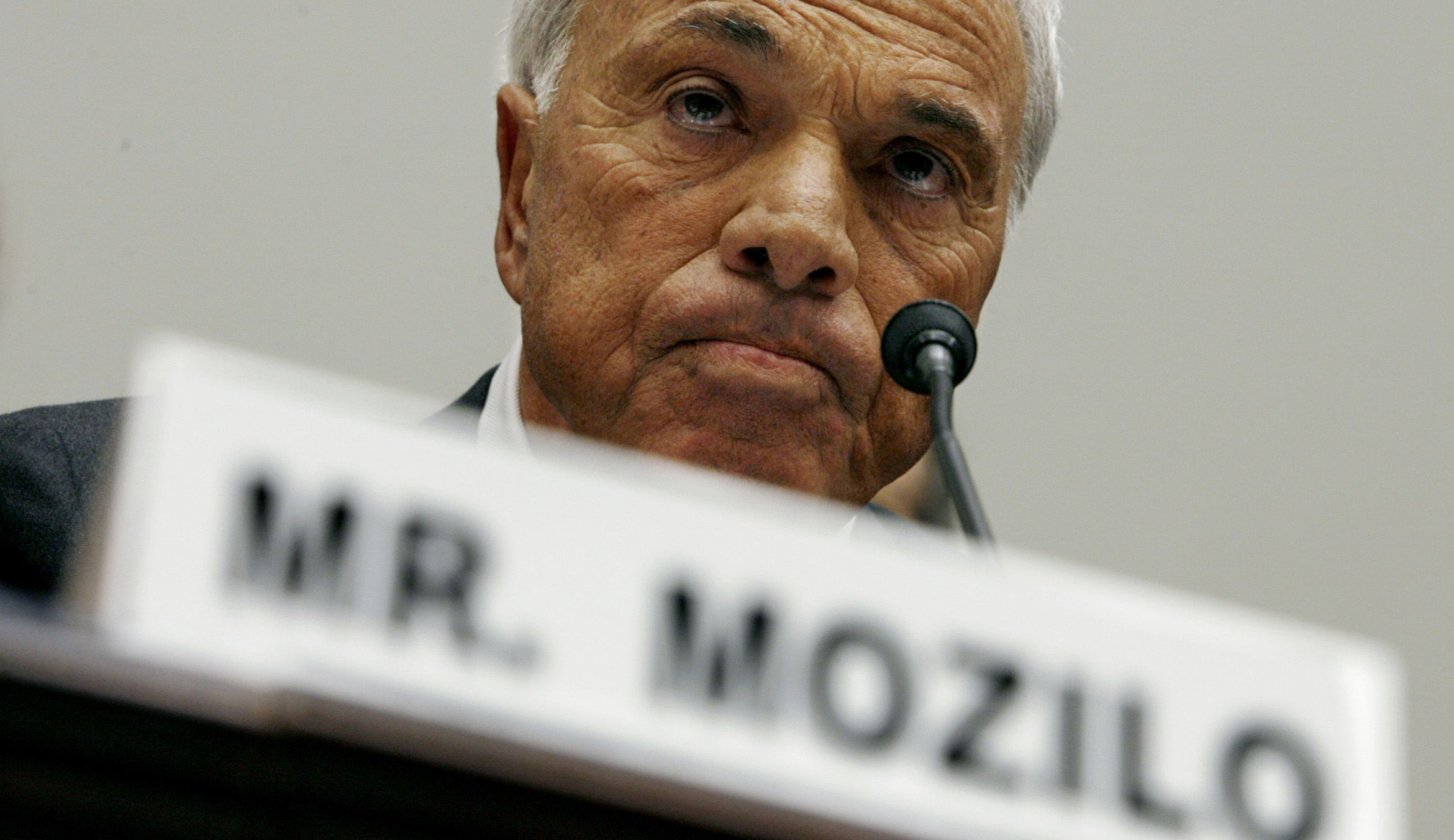 Countrywide Financial  Corporation founder and CEO Angelo Mozilo testifies before the House Committee on Oversight and Government Reform on Capitol Hill in Washington in this March 7, 2008 file photo. U.S. stock regulators filed a civil lawsuit in Los Angeles June 4, 2009, accusing Mozilo, former Countrywide President David Sambol and former Chief Financial Officer Eric Sieracki of misleading investors about credit risks taken to build and maintain the lender's market share. REUTERS/Kevin Lamarque/Files              (UNITED STATES POLITICS BUSINESS) - RTR24AK0