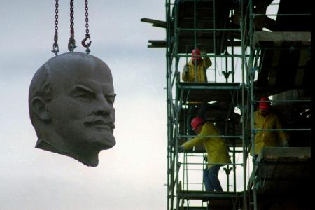 A statue of Lenin being dismantled in Berlin in 1991
