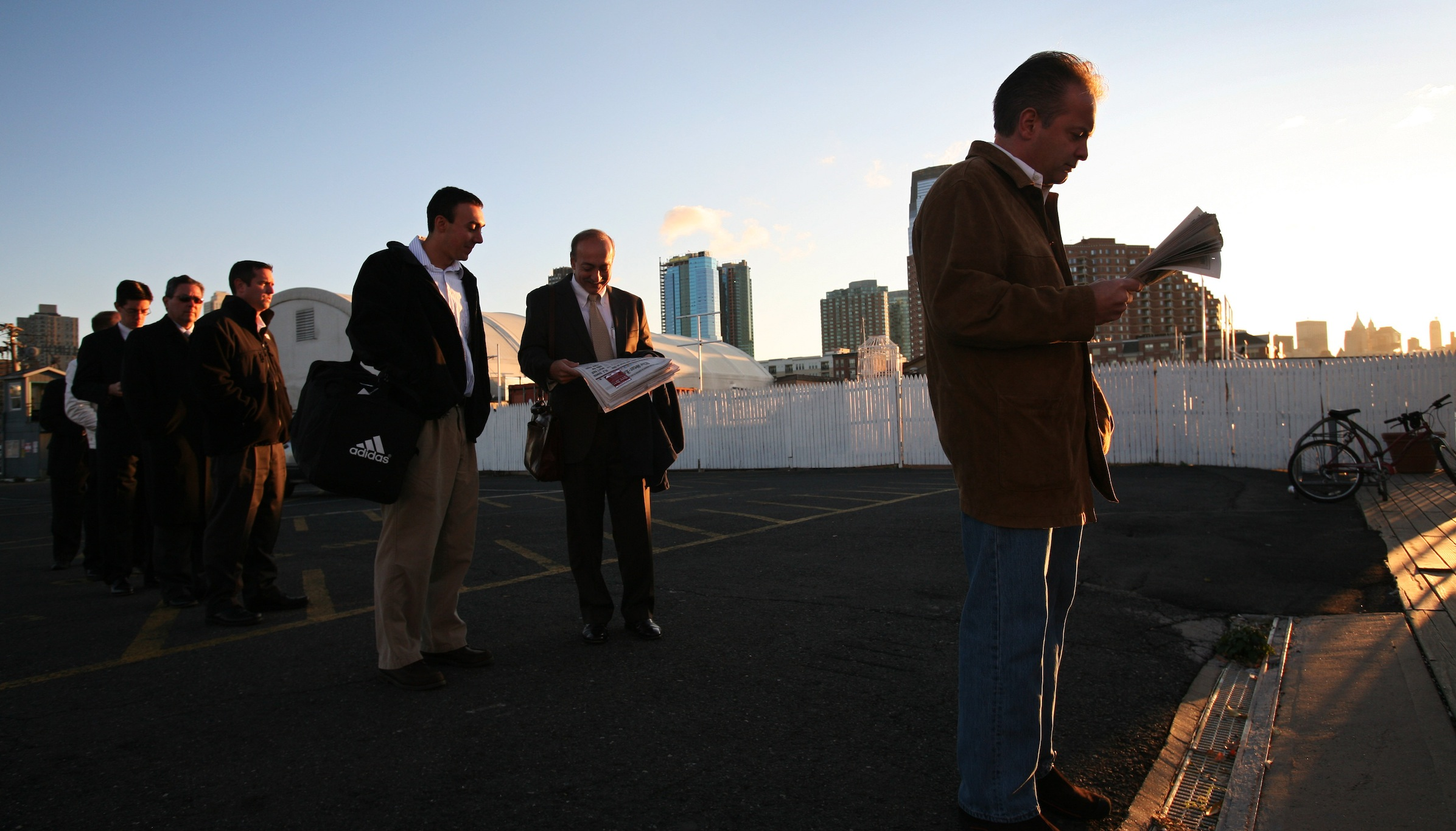 Eric Kurschus, right, a bond trader with Citation Financial Group, reads the Wall Street Journal as he waits to take a commuter ferry in Jersey City, N.J. to New York's financial district on Thursday, Oct. 23, 2008. Traders and investment bankers might have more to worry about than dwindling bonus pools this year as mass firings on Wall Street are set to hit a record. The fallout from this year's global credit crisis has claimed jobs on all corners of Wall Street, from hedge fund managers to floor traders and beyond. More than 110,000 have lost their jobs so far this year, and some industry experts forecast it could come close to 200,000 before the year is over. (AP Photo/Mark Lennihan)