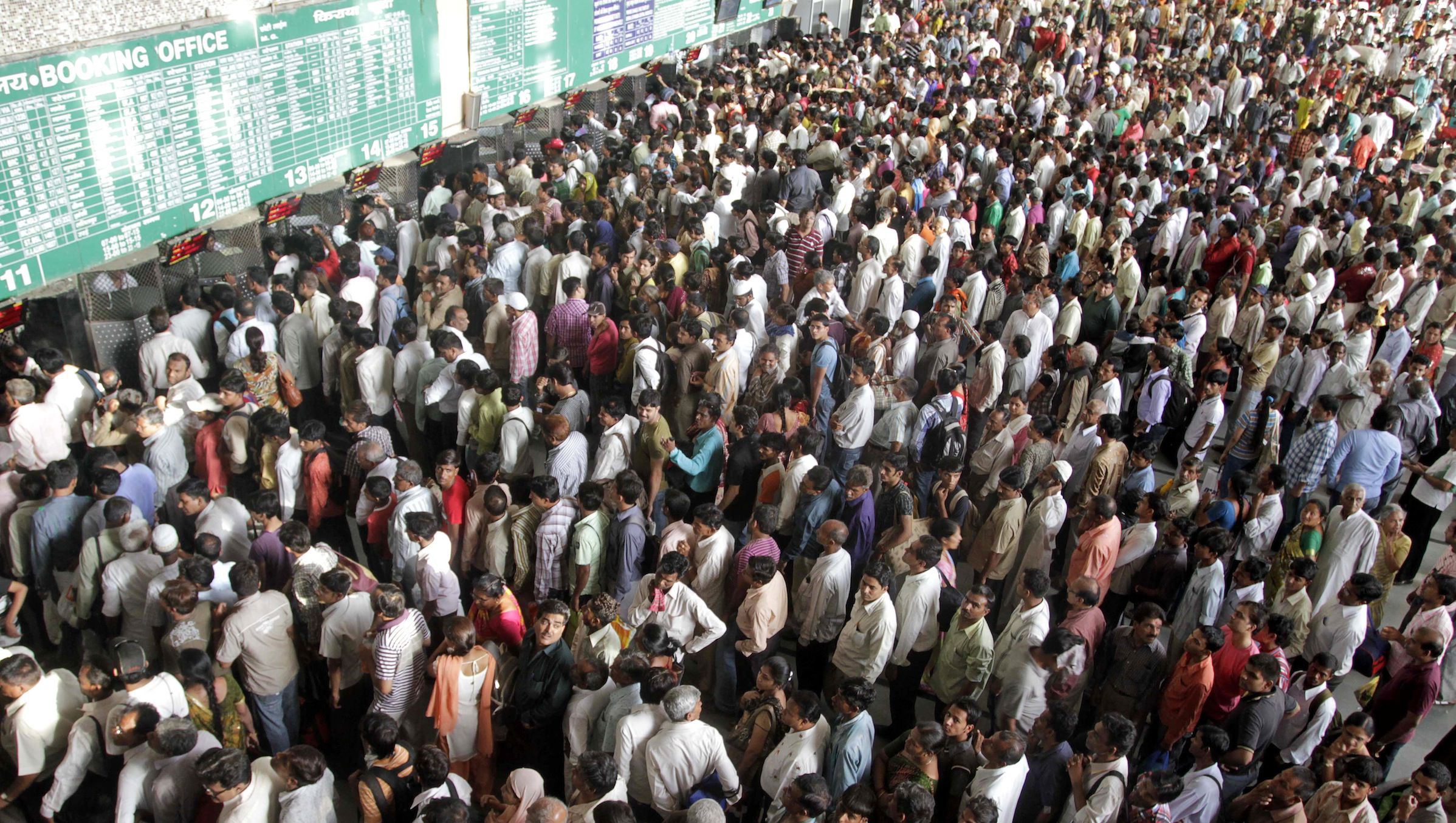 Indians crowd ticket counters at the railway station in Ahmadabad, India, Sunday, May 8, 2011. People crowded the railway station for tickets to get away for the summer as school vacations begin May 9. (AP Photo/Ajit Solanki)