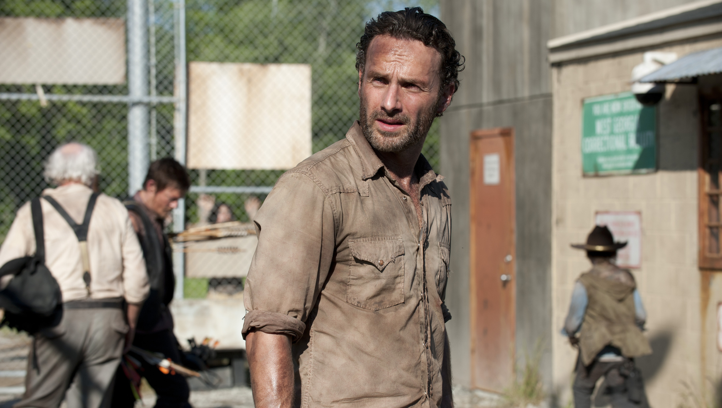 "In this publicity photo provided by AMC, actor, Andrew Lincoln, as Rick Grimes, center, is shown in a scene from AMC's ""The Walking Dead,"" Season 3, Episode 1. (AP Photo/AMC, Gene Page)"