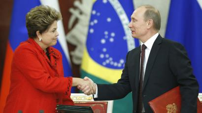Russian President Vladimir Putin and Brazilian President Dilma Rousseff shake hands during a signing ceremony in the Kremlin in Moscow .