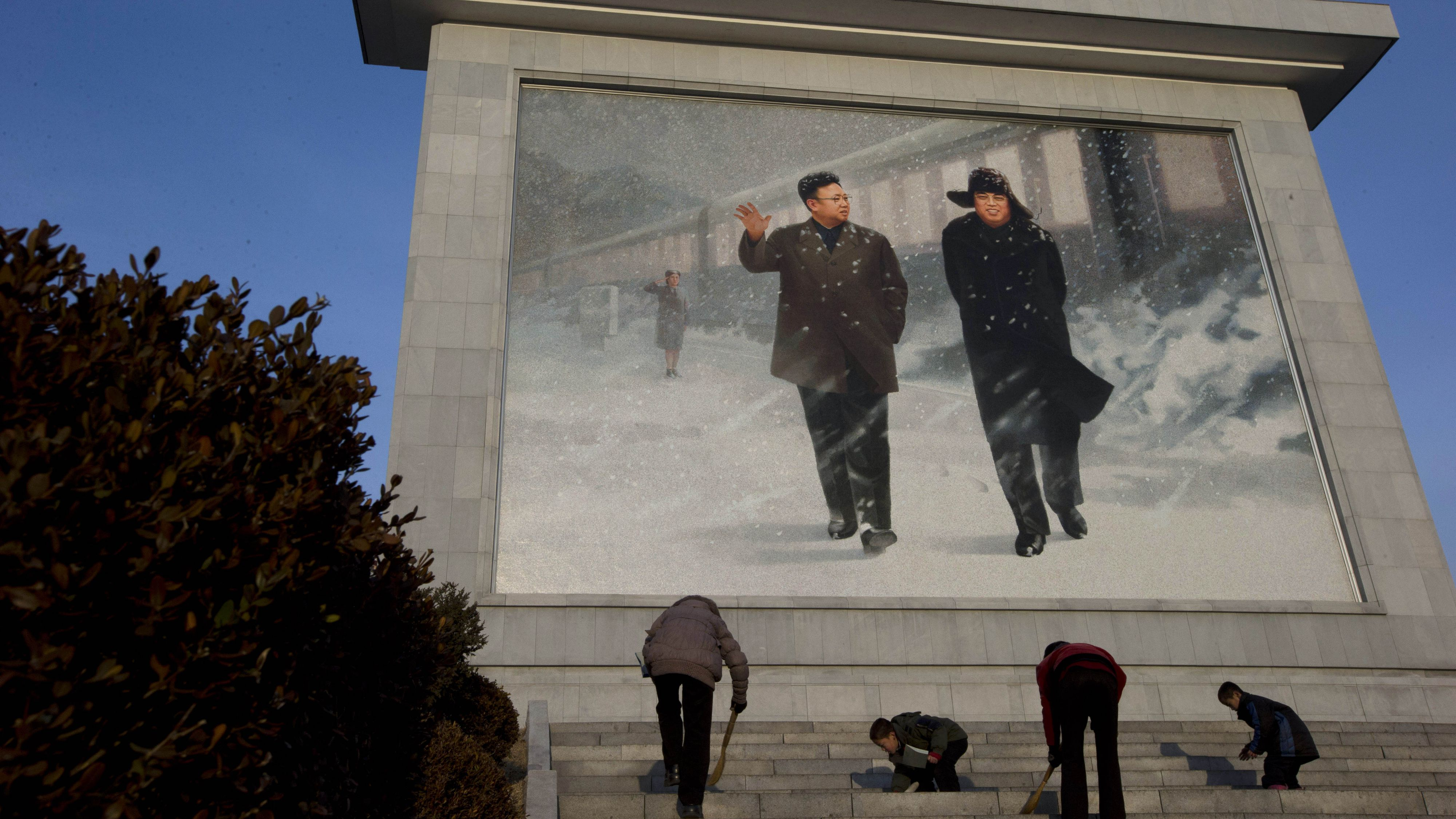 A giant portrait of late North Korean leaders Kim Jong Il and Kim Il Sung in Pyongyang