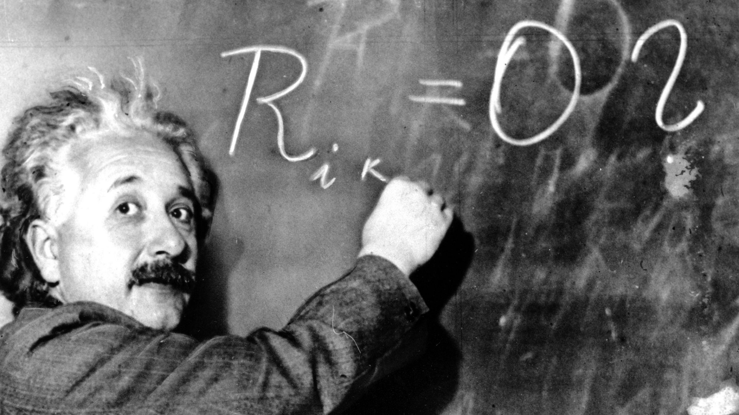Dr. Albert Einstein writes out an equation for the density of the Milky Way on the blackboard at the Carnegie Institute, Mt. Wilson Observatory headquarters in Pasadena, Calif., on Jan. 14, 1931. Einstein achieved world reknown in 1905, at age 26, when he expounded his Special Theory of Relativity which proposed the existence of atomic energy. Though his concepts ushered in the atomic age, he was a pacifist who warned against the arms race. Einstein, who radically changed mankind's vision of the universe, was awarded the Nobel Prize for Physics in 1921. (AP Photo)