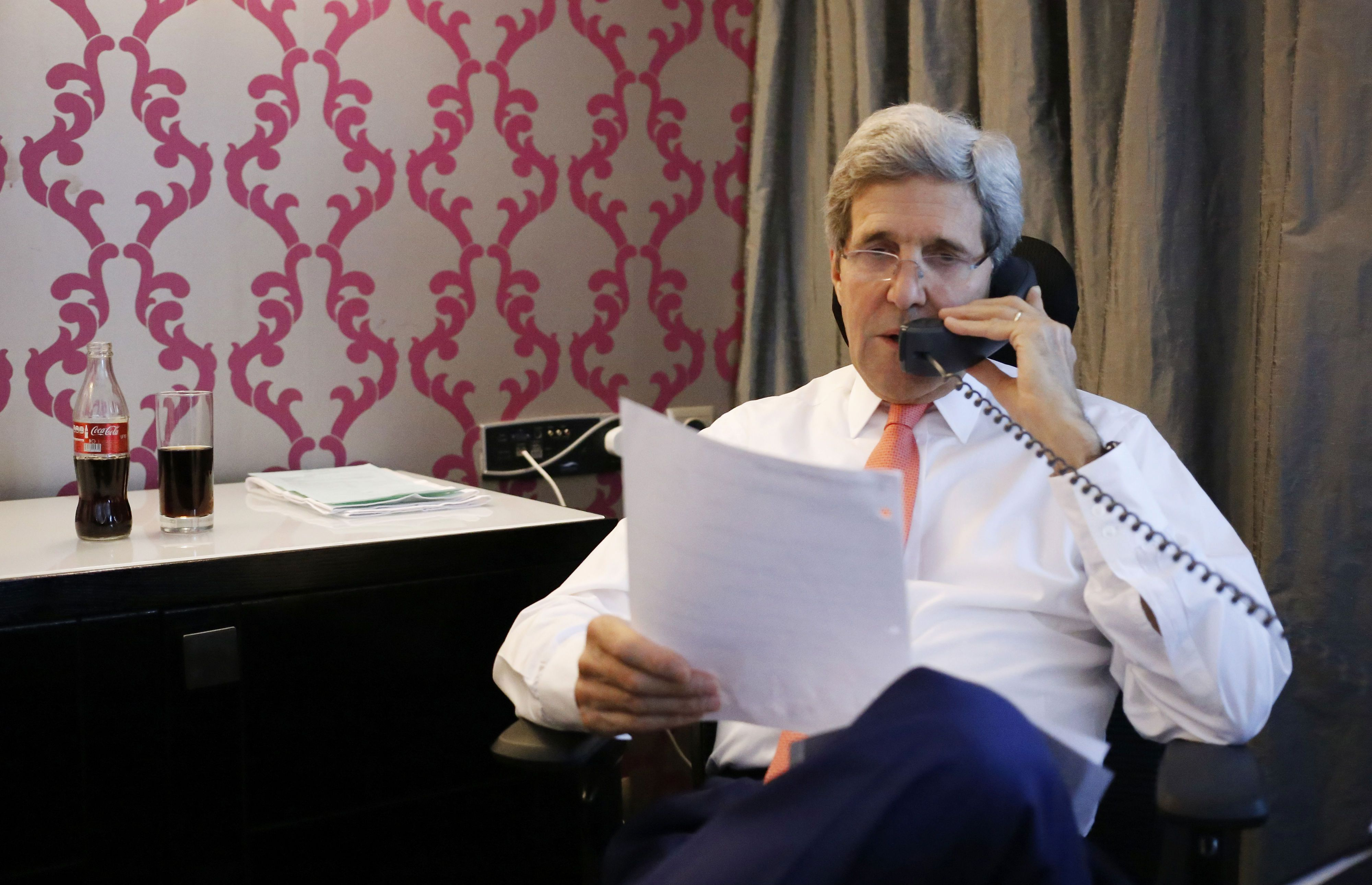 U.S. Secretary of State John Kerry talks to Israeli Prime Minister Benjamin Netanyahu about terms of a cease-fire in fighting in Gaza between Israel and Hamas, Friday, July 25, 2014, from his hotel suite in Cairo, Egypt. (AP Photo/Charles Dharapak)
