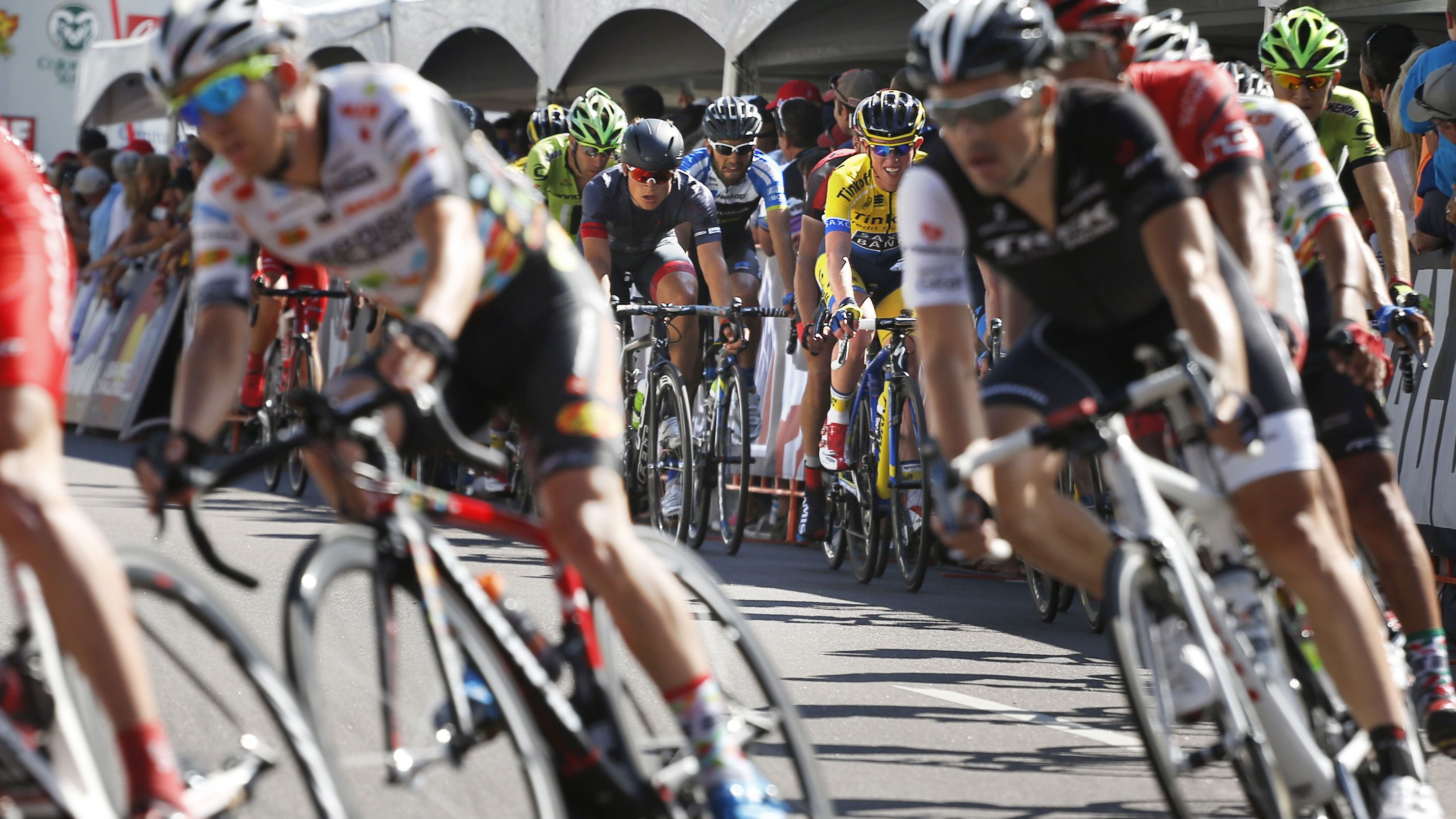 Riders enter a turn during the seventh and final stage of the USA Pro Challenge bike race, in Denver, Sunday Aug. 24, 2014. The 78-mile seventh stage started in Boulder, looped above Golden, and finished up with several laps around downtown Denver. (AP Photo/Brennan Linsley)