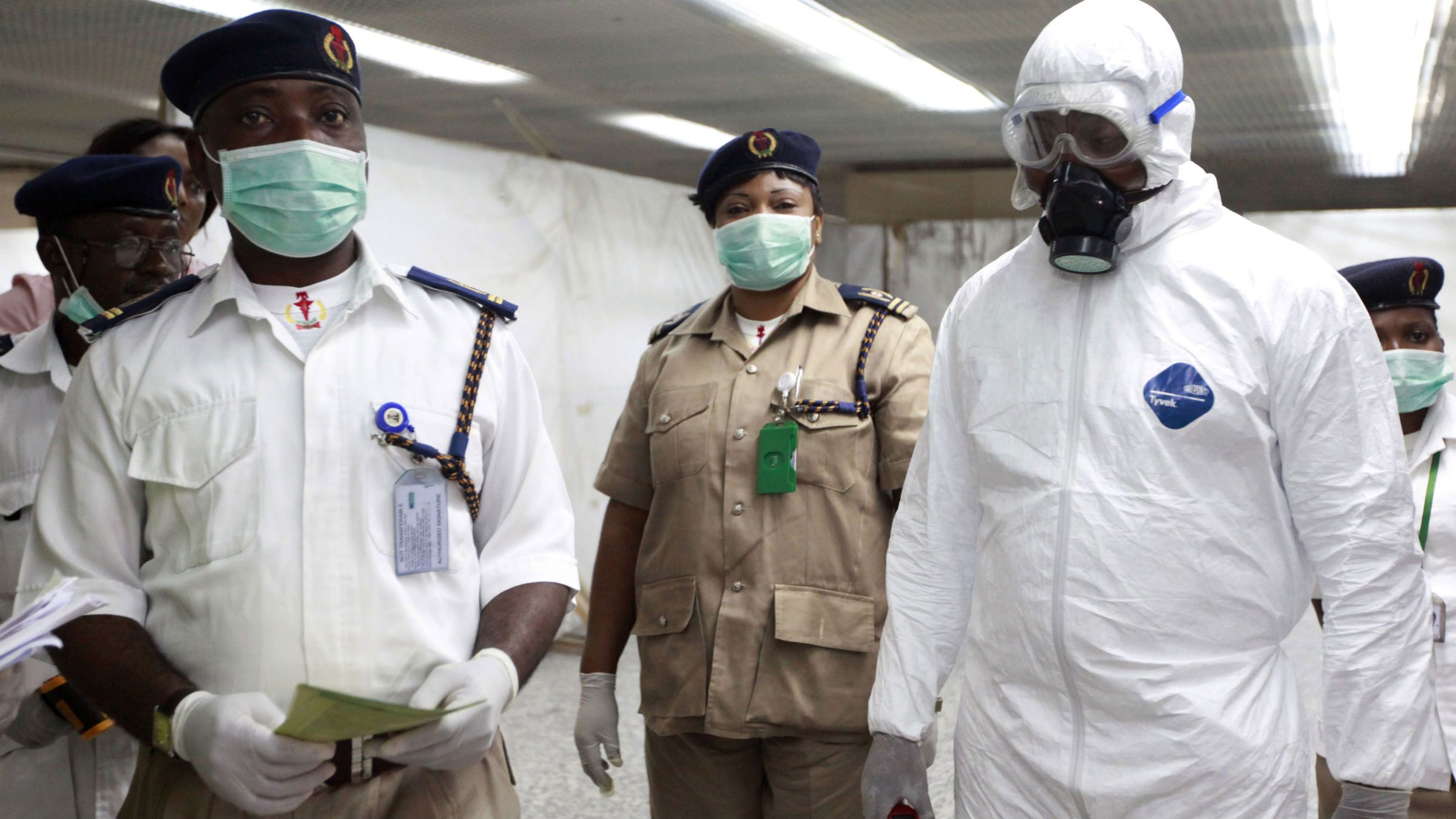 Nigerian health officials wait to screen passengers at the arrivals hall of Murtala Muhammed International Airport in Lagos, Nigeria, Monday, Aug. 4, 2014. Nigerian authorities on Monday confirmed a second case of Ebola in Africa's most populous country, an alarming setback as officials across the region battle to stop the spread of a disease that has killed more than 700 people. (AP Photo/Sunday Alamba)