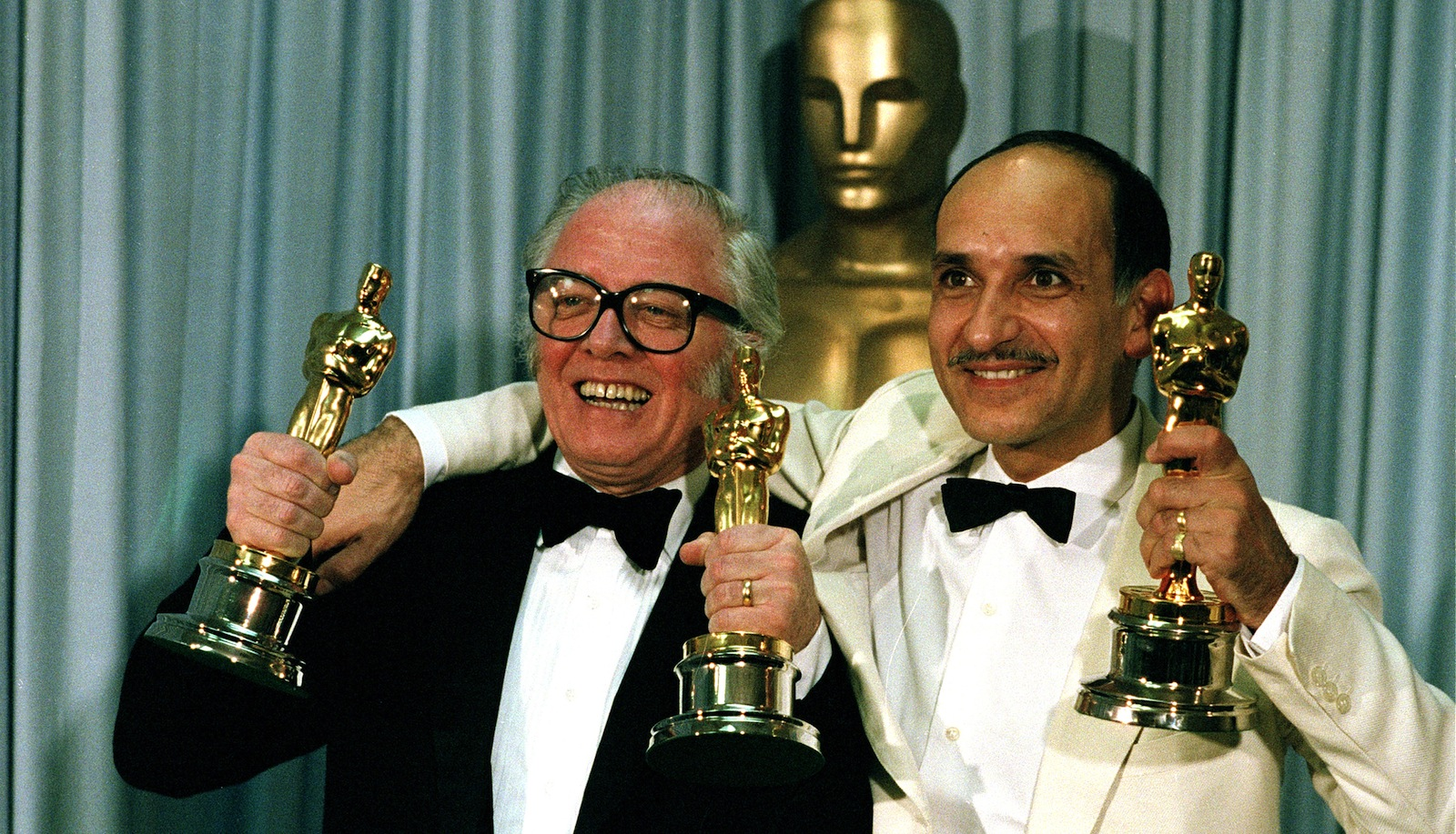 """Director Richard Attenborough, left, and actor Ben Kingsley pose with their Oscars at the 55th annual Academy Awards in Hollywood, Calif., on April 11, 1983. Attenborough won best director and best picture for """"Gandhi,"""" and Kingsley won best actor for his portrayal of the title role in the drama. (AP Photo/Reed Saxon)"""