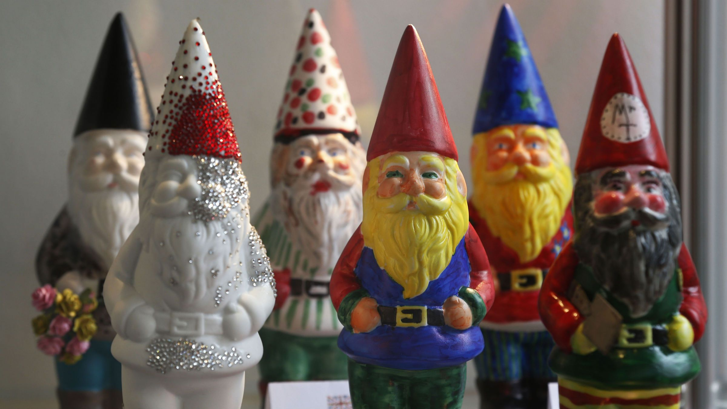 Garden gnomes painted by celebrities are seen on display during the Chelsea Flower Show in London, Monday, May 20, 2013. Chelsea Flower Show celebrates its centenary anniversary this year, has temporarily lifted its 100-year ban on garden gnomes, and marks it anniversary by unveiling over 100 gnomes painted for charity by celebrities and will be auctioned on eBay during the RHS Chelsea Flower Show. (AP Photo/Sang Tan)