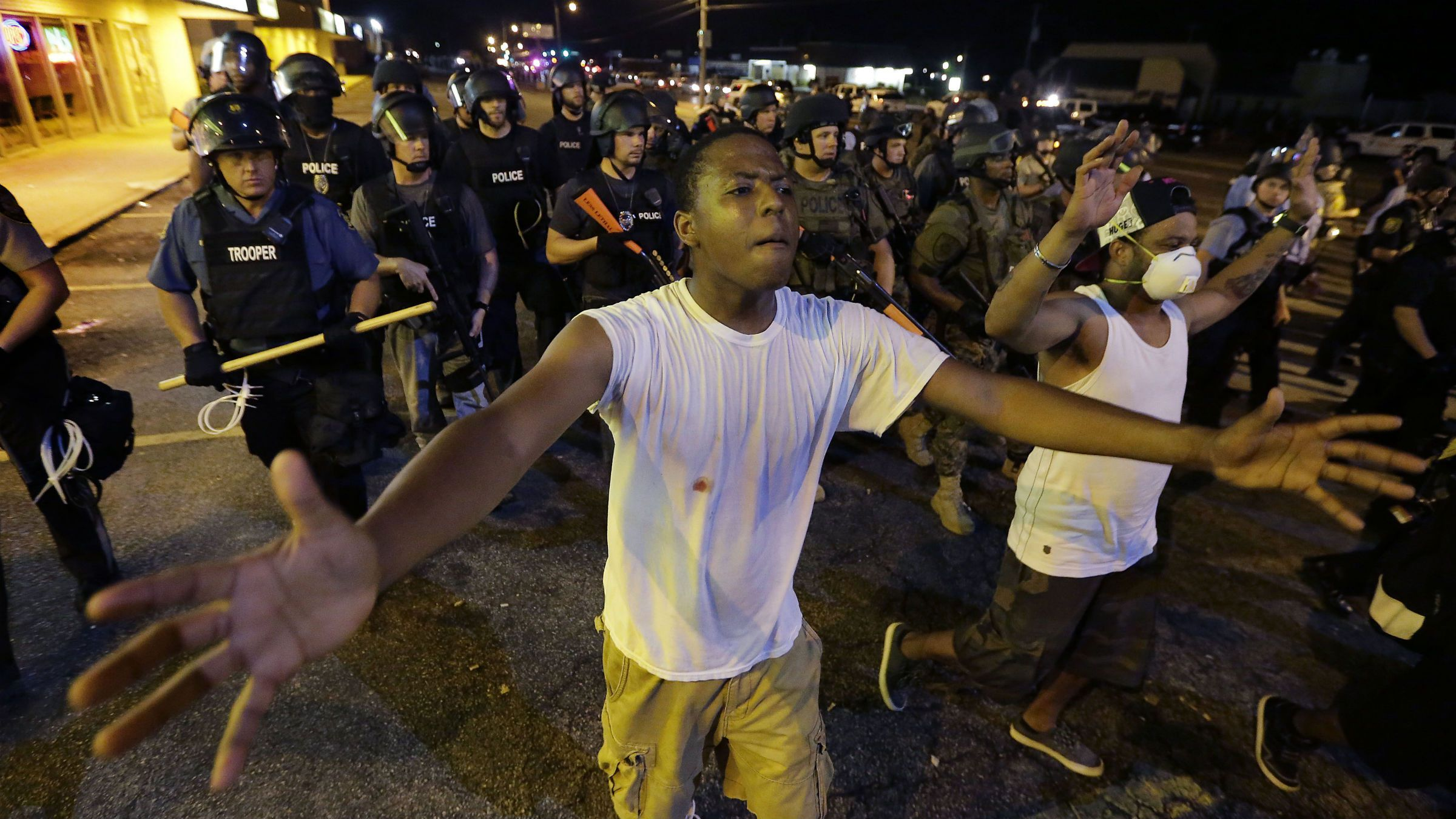 A young black man protests in Ferguson