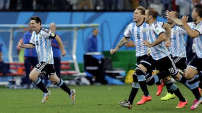Argentina's Lionel Messi, left, reacts with his teammates after Maxi Rodriguez scored the winning goal during a penalty shootout after extra time during the World Cup semifinal soccer match between the Netherlands and Argentina at the Itaquerao Stadium in Sao Paulo Brazil, Wednesday, July 9, 2014. Argentina defeated the Netherlands 4-2 in a penalty shootout after a 0-0 tie to advance to the finals. (AP Photo/Victor R. Caivano)