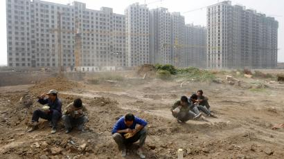 affordable housing social gdp home sales prices housing real estate property market collapse crash bubble Labourers have their lunch at a construction site in Taiyuan, Shanxi province September 29, 2009. China's provincial and municipal governments should provide more land for use for affordable housing in order to help combat the impact of a recent run-up in prices, a senior official said on Monday. REUTERS/Stringer