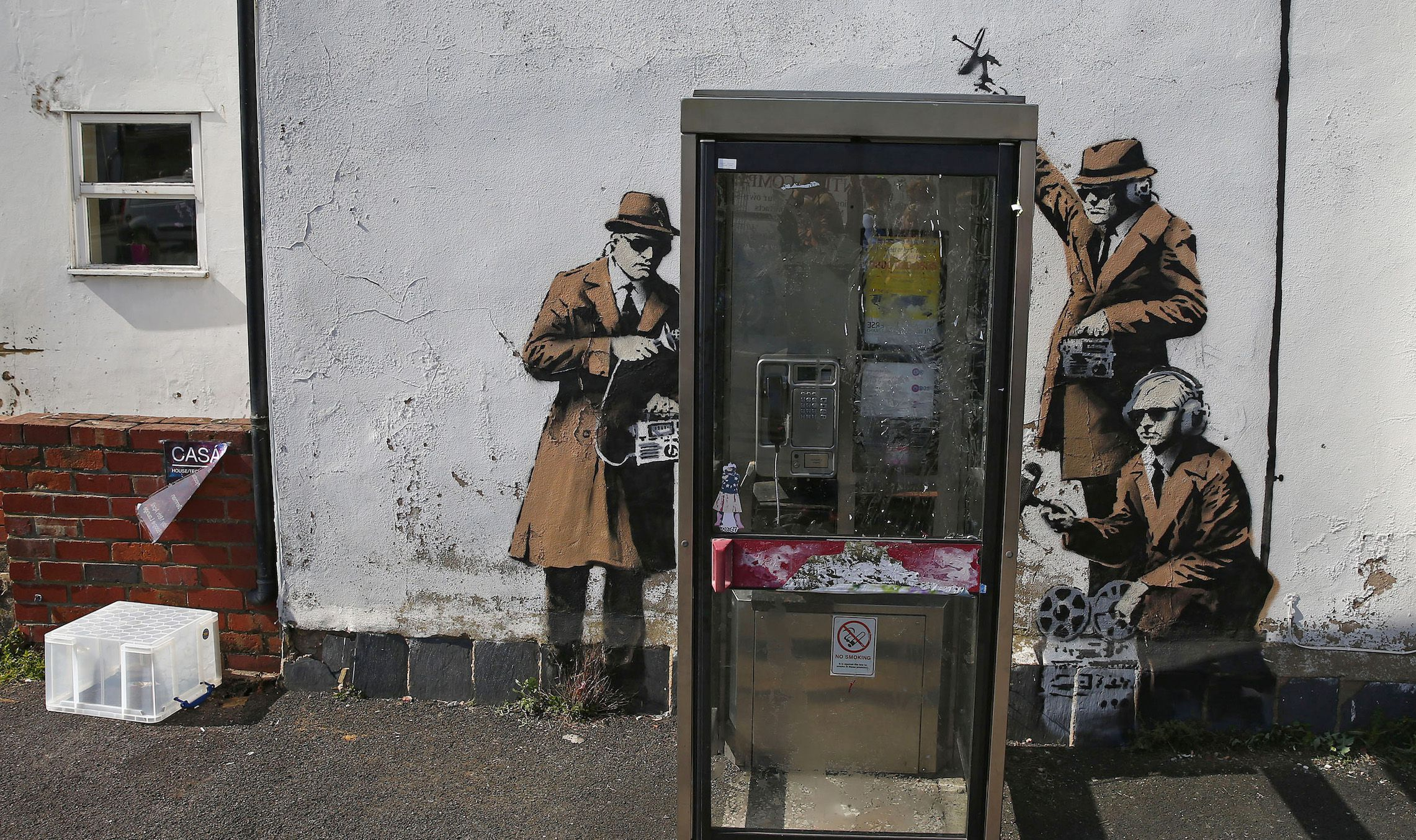 Graffiti art is seen on a wall near the headquarters of Britain's eavesdropping agency, Government Communications Headquarters, known as GCHQ, in Cheltenham, western England April 16, 2014. British media have attributed the new work to acclaimed British street artist Banksy, as a spoof on recent government spying scandals exposed by former U.S. National Security Agency contractor, Edward Snowden, who said that Britain's agency, GCHQ tapped fiber-optic cables carrying international phone and internet traffic and is sharing vast quantities of personal information with the NSA.  REUTERS/Eddie Keogh (BRITAIN - Tags: SOCIETY POLITICS) - RTR3LJIO