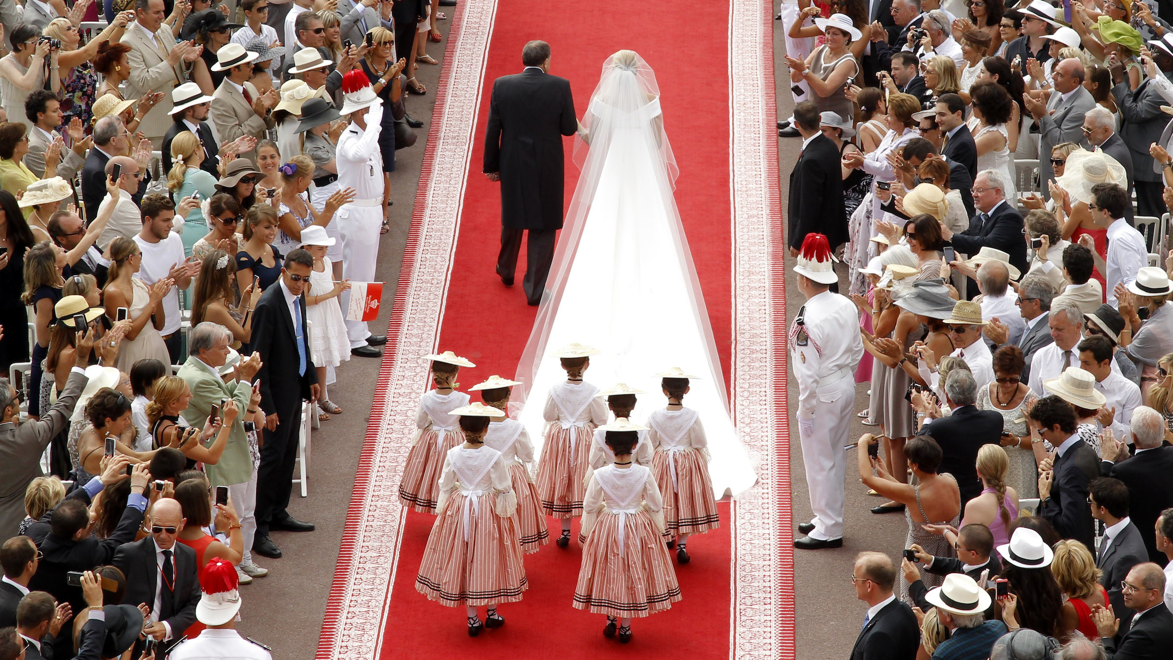 Michael Kenneth Wittstock (L) escorts his daughter Princess Charlene on the red carpet at the Place du Palais for the religious wedding ceremony with Prince Albert II at the Palace in Monaco July 2, 2011. REUTERS/Benoit Tessier (MONACO  - Tags: ROYALS ENTERTAINMENT IMAGES OF THE DAY)  (MONACO ROYAL WEDDING)     - RTR2ODKS