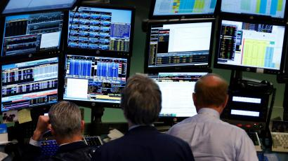 Traders work at Bloomberg terminals on the floor of the New York Stock Exchange, May 13, 2013. Bloomberg LP customers, including the U.S. Federal Reserve and the U.S. Treasury, are examining whether there could have been leaks of confidential information, even as the media company restricted its reporters' access to client data and created a position to oversee compliance in a bid to assuage privacy concerns. Bloomberg has more than 315,000 terminal subscribers globally, with each Bloomberg terminal costing more than $20,000 a year.
