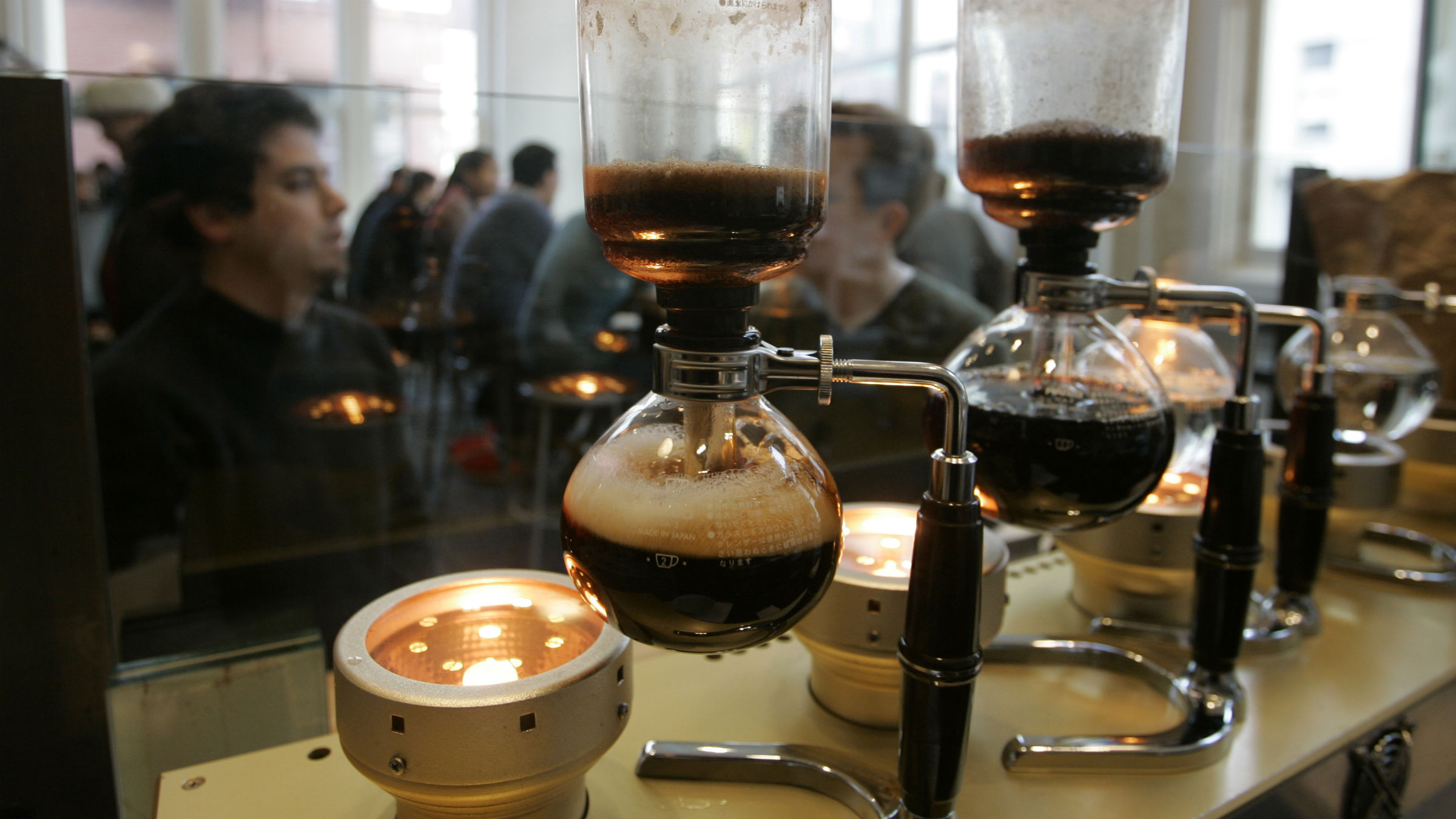 Coffee made in a siphon forms bubbles as it drips back into a pot at the Blue Bottle Cafe in San Francisco, Tuesday, Dec. 16, 2008. The artisan microroaster opened the cafe earlier this year and the halogen-powered siphon bar from Japan makes coffees that sell from $6 a cup to $9 to $12 a pot. The siphon produces a coffee described as delicate and soft, with flavors that change as the temperature changes.