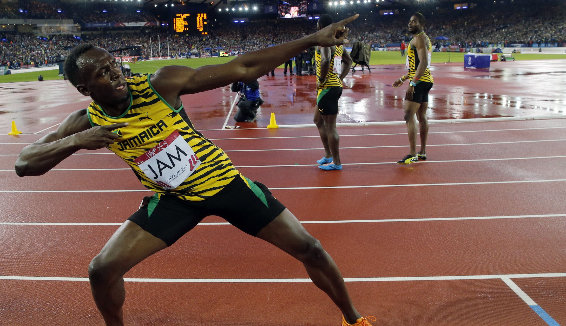 Jamaica's Usain Bolt poses after Jamaica won the men's 4x100m relay final at the 2014 Commonwealth Games in Glasgow, Scotland, August 2, 2014.                  REUTERS/Suzanne Plunkett (BRITAIN  - Tags: SPORT ATHLETICS)   - RTR41142