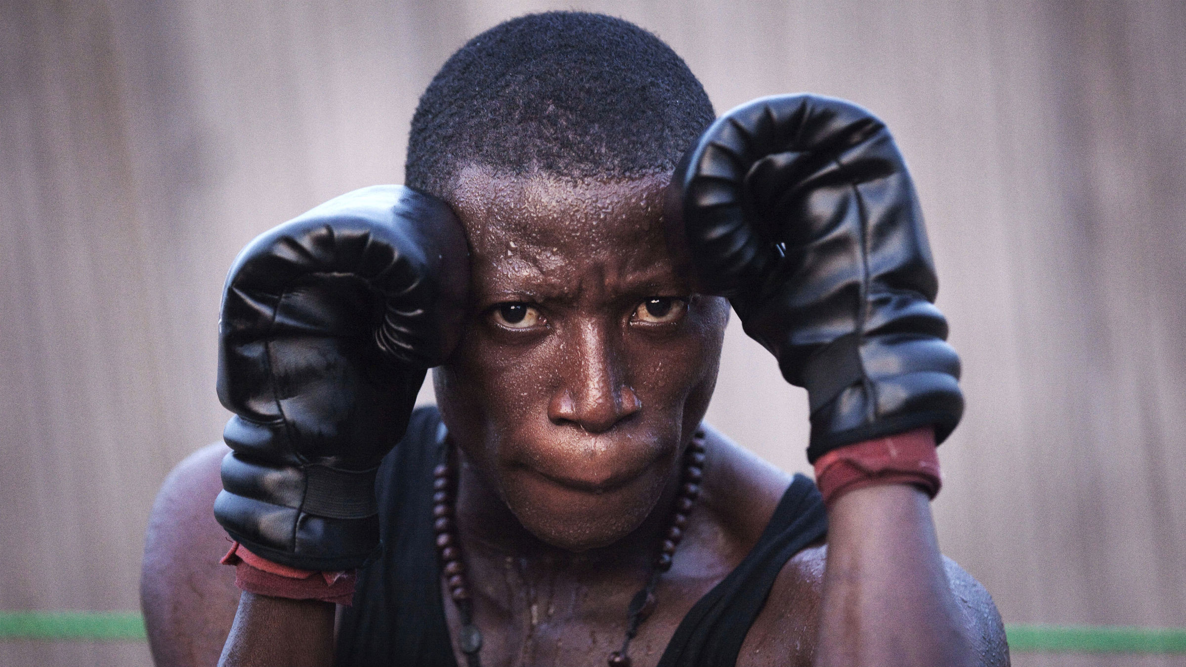 Samuel Amoo, 26, works out during a training session at the Afro Boxing Club in the Akpakpa neighbourhood of Benin's capital Cotonou, November 16, 2011.