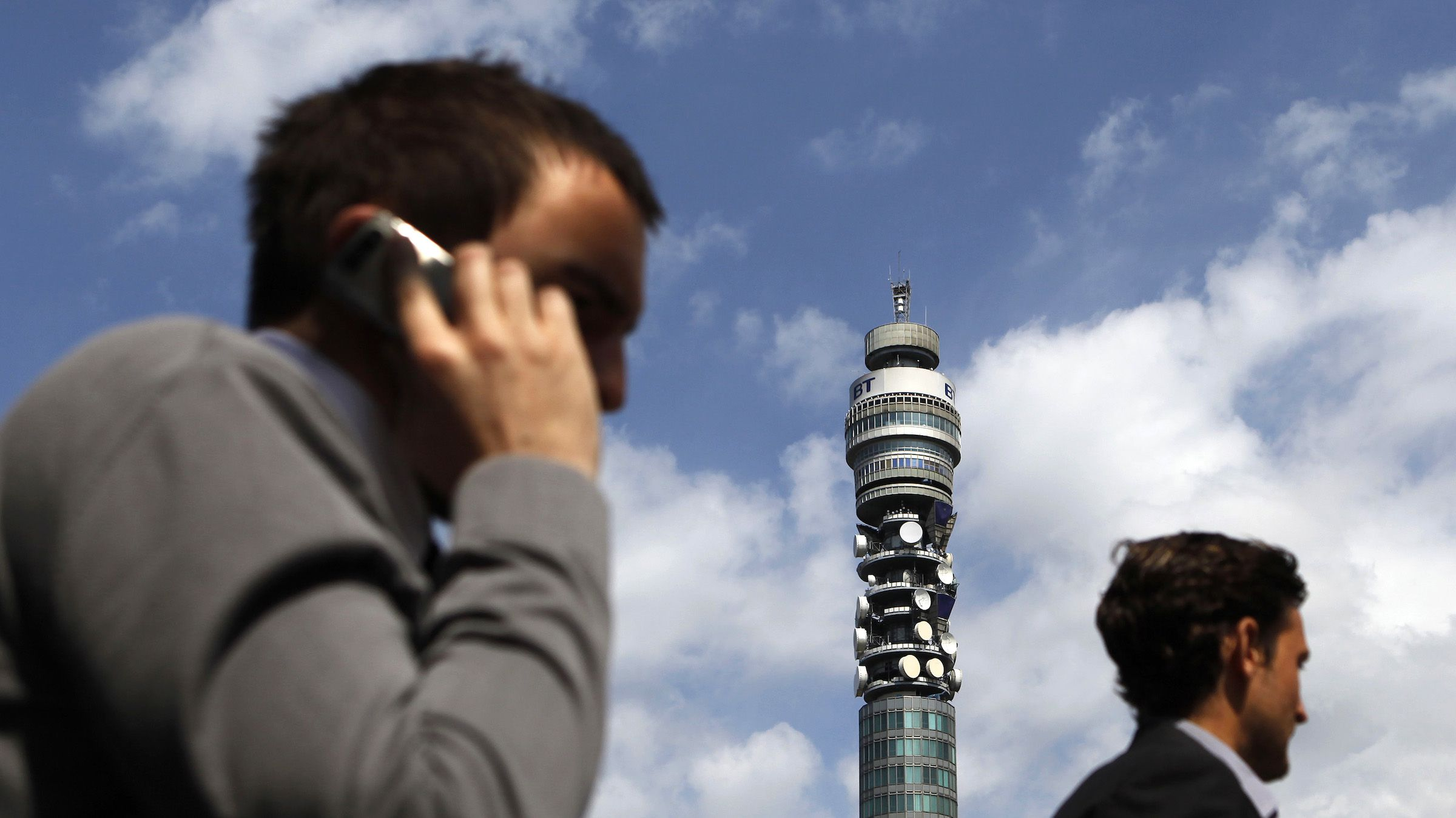 A pedestrian speaks on a mobile phone