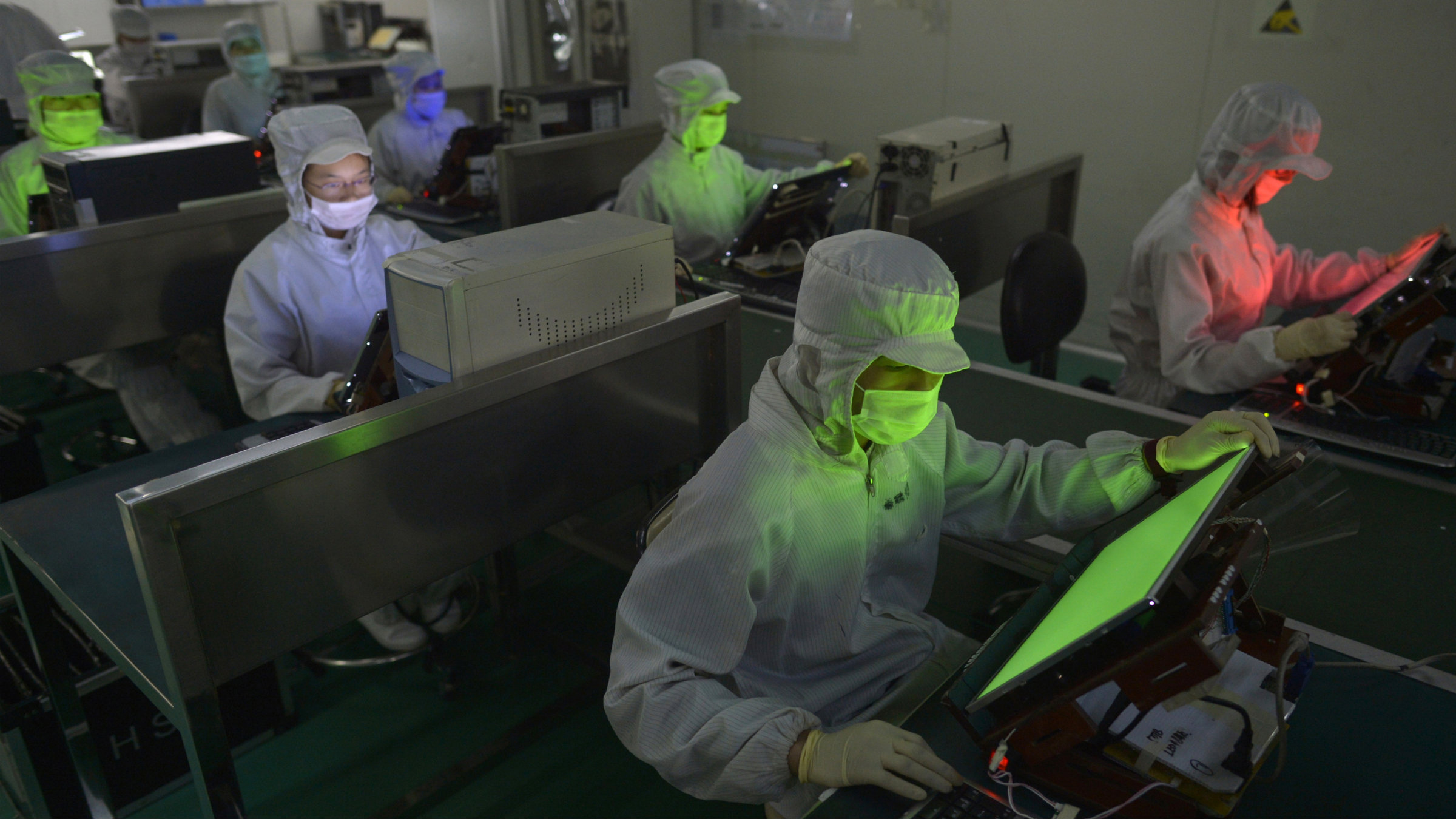 Employees work inside a LCD factory in Wuhan, Hubei province,