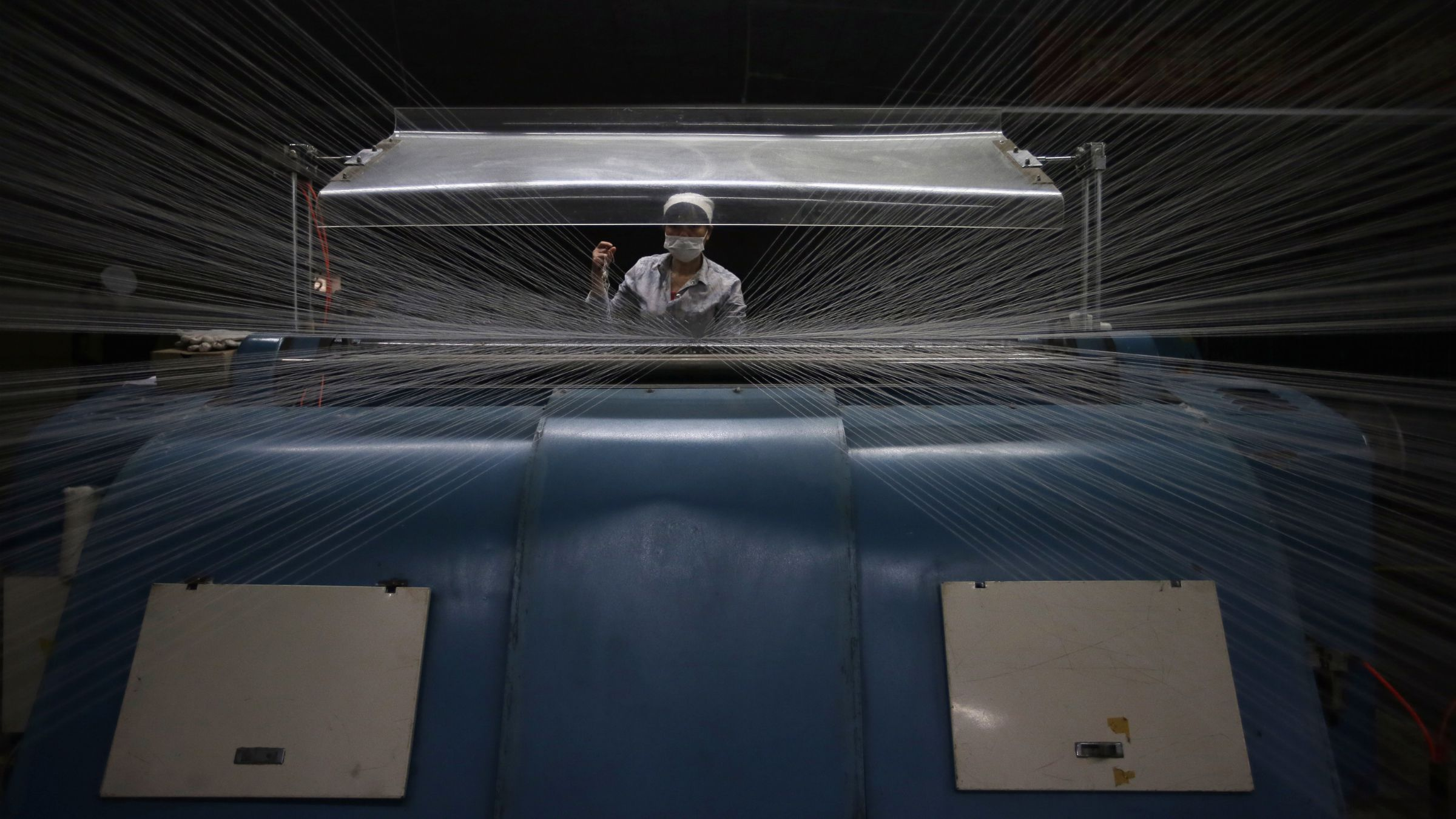 An employee works at a textile factory in Wuhan, Hubei province, April 30, 2014. Activity in China's factories increased marginally in April but export orders fell sharply, a government survey showed on Thursday, adding to questions about whether the world's second-largest economy is stabilising after its first-quarter slowdown. REUTERS/Stringer