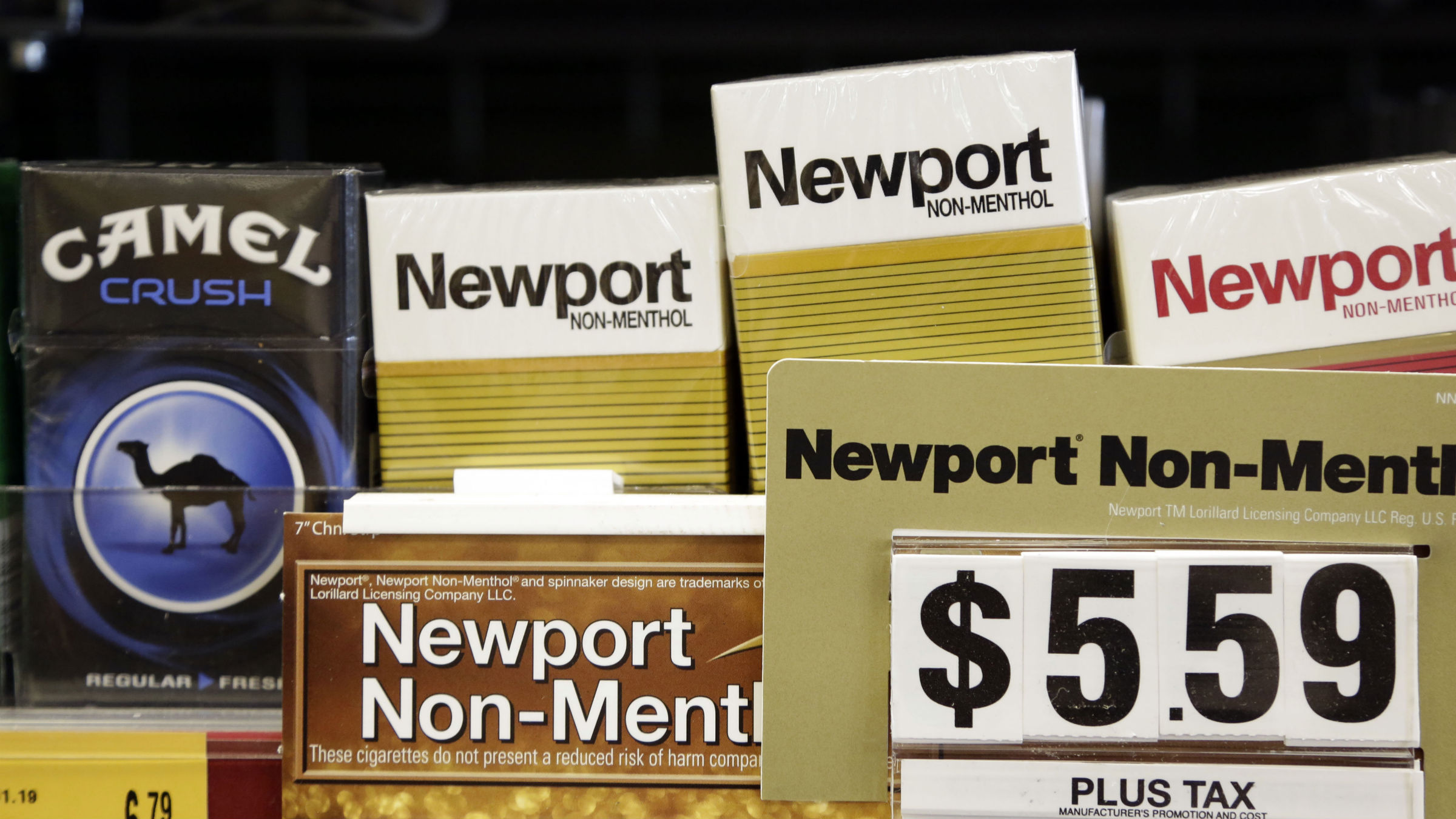 Camel, a Reynolds American brand, and Newport, a Lorillard brand, cigarettes are displayed for sale, Tuesday, July 15, 2014, in Doral, Fla. Cigarette maker Reynolds American Inc. is planning to buy rival Lorillard Inc. for about $25 billion in a deal to combine two of the nation's oldest and biggest tobacco companies.