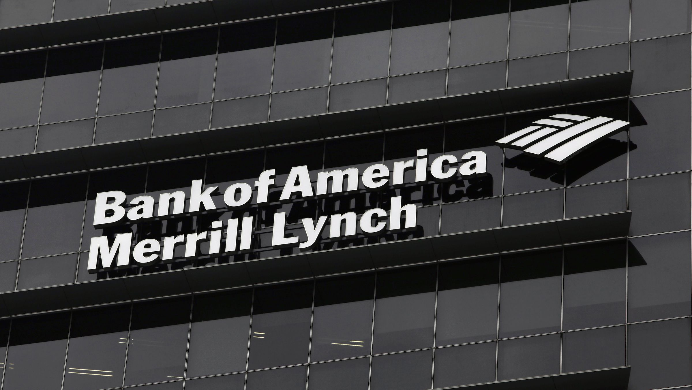 A Bank of America Merrill Lynch sign is seen on a building that houses its offices in Singapore May 17, 2012. Royal Bank of Canada and Credit Suisse are among the suitors seeking to bid for the non-U.S. wealth management businesses of Bank of America Merrill Lynch, sources told Reuters, in a deal that could be worth around $2 billion. REUTERS/Tim Chong (SINGAPORE - Tags: BUSINESS LOGO) - RTR326LT