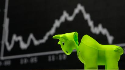 A bull styrofoam figure is pictured in front of the DAX board at the Frankfurt stock exchange