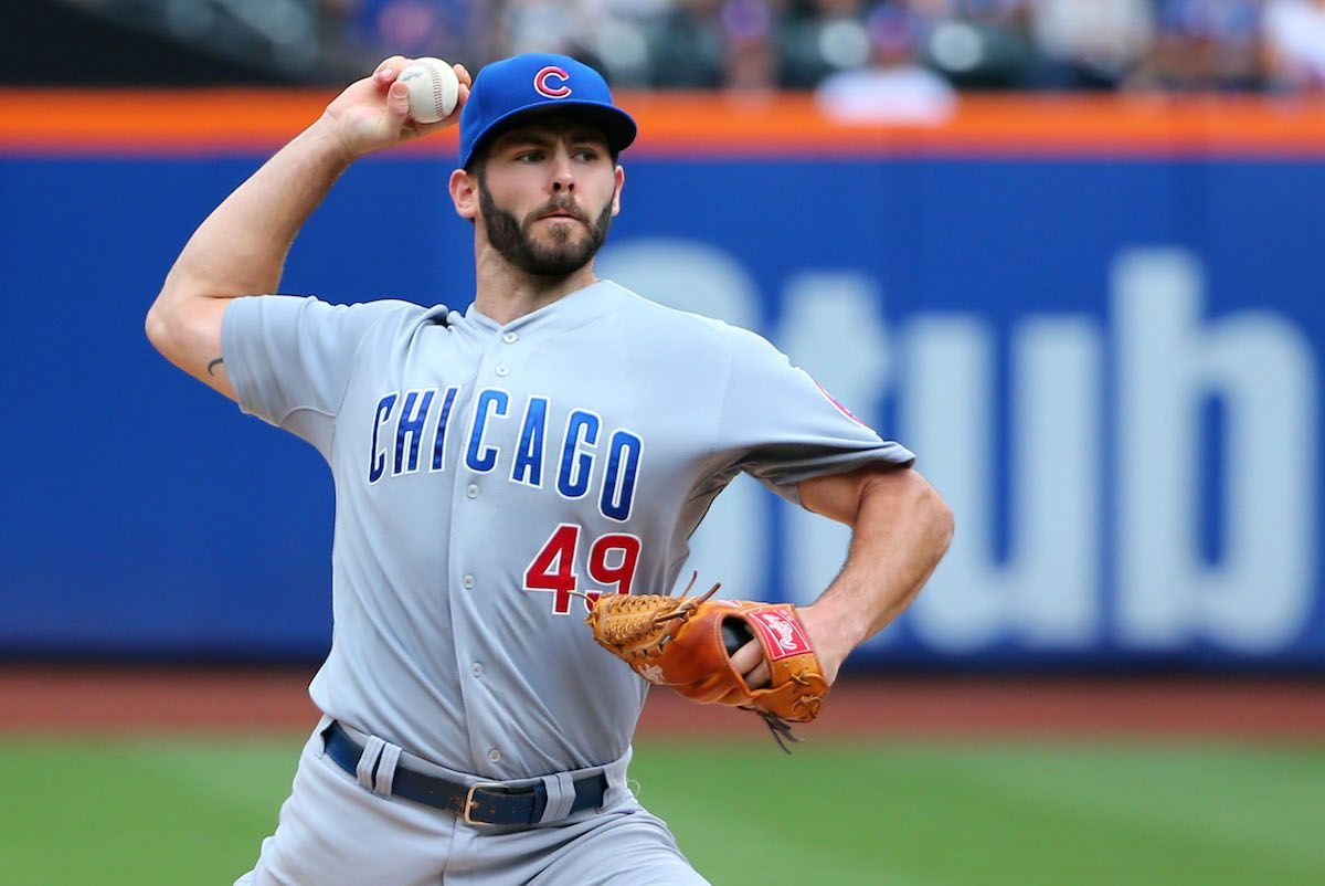 Aug 17, 2014; New York, NY, USA; Chicago Cubs starting pitcher Jake Arrieta (49) pitches during the first inning against the New York Mets at Citi Field. Mandatory Credit: Anthony Gruppuso-USA TODAY Sports - RTR42QL2