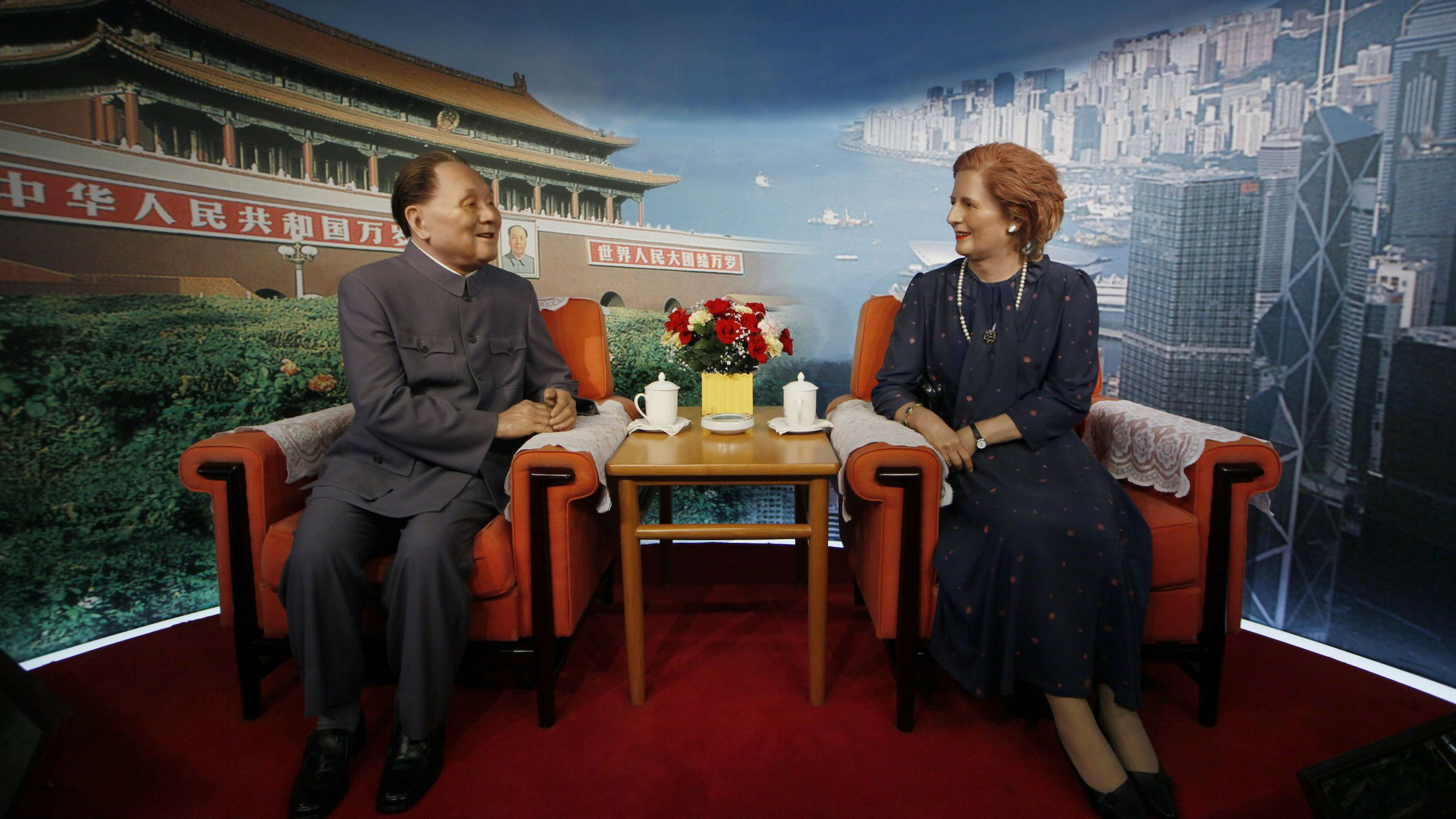 The wax statues setting featuring former British Prime Minister Margaret Thatcher talking with former Chinese leader Deng Xiaoping in the Beijing's Great Hall of the People are on display in an exhibition center in Shenzhen, China Tuesday, April 9, 2013.