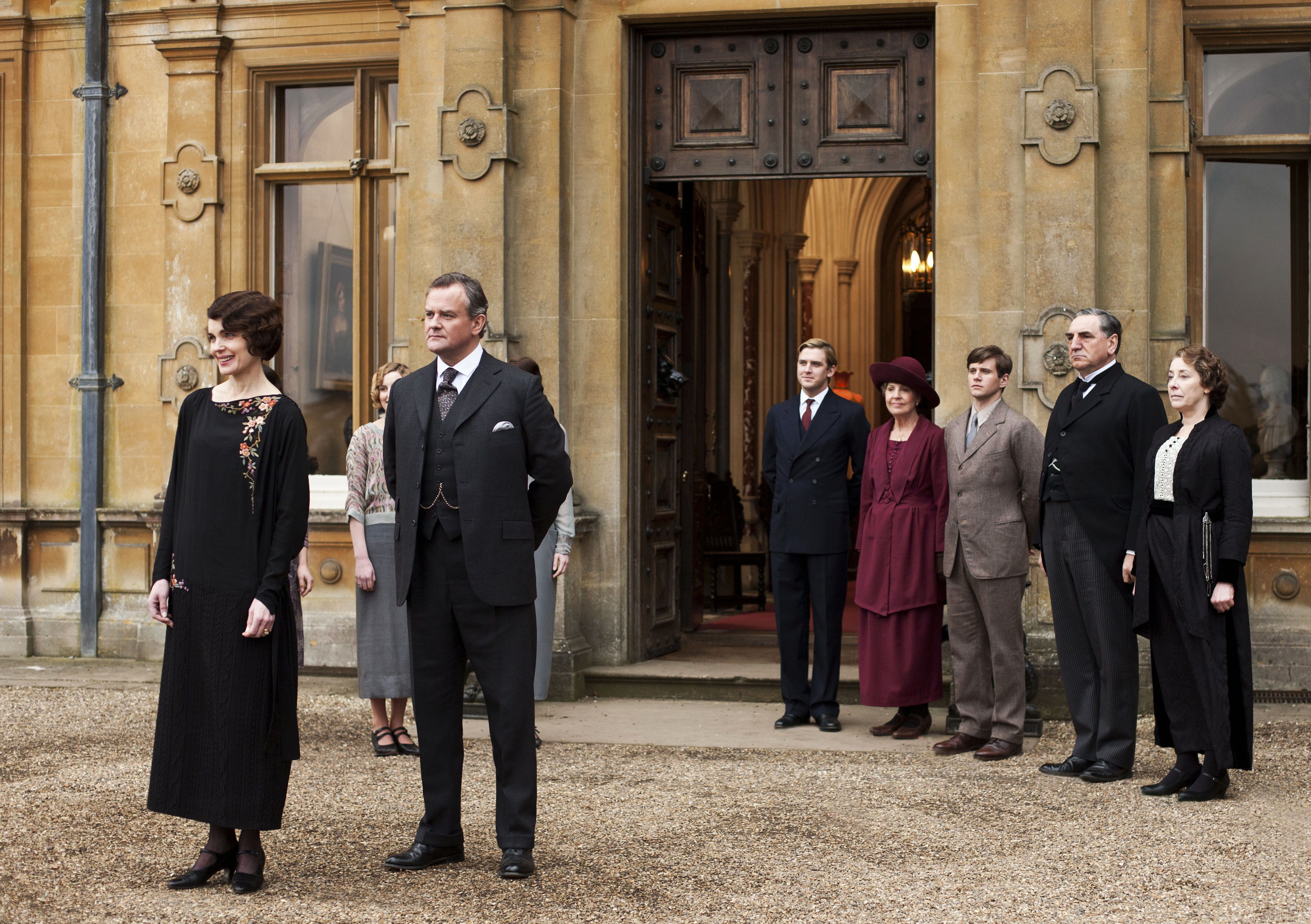 """This undated publicity photo provided by PBS shows, from left, Elizabeth McGovern as Lady Grantham, Hugh Bonneville as Lord Grantham, Dan Stevens as Matthew Crawley, Penelope Wilton as Isobel Crawley, Allen Leech as Tom Branson, Jim Carter as Mr. Carson, and Phyllis Logan as Mrs. Hughes, from the TV series, """"Downton Abbey."""" The show was nominated for a Golden Globe for best drama series on Thursday, Dec. 12, 2013. The 71st annual Golden Globes will air on Sunday, Jan. 12."""