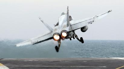 A picture taken Monday, Feb. 13, 2012 shows, a U.S. F-18 fighter jet takes off from the Nimitz-class aircraft carrier USS Abraham Lincoln (CVN 72) during fly exercises in the Persian Gulf. The Carrier sailed from the Persian Gulf through the Strait of Hormuz on Tuesday.