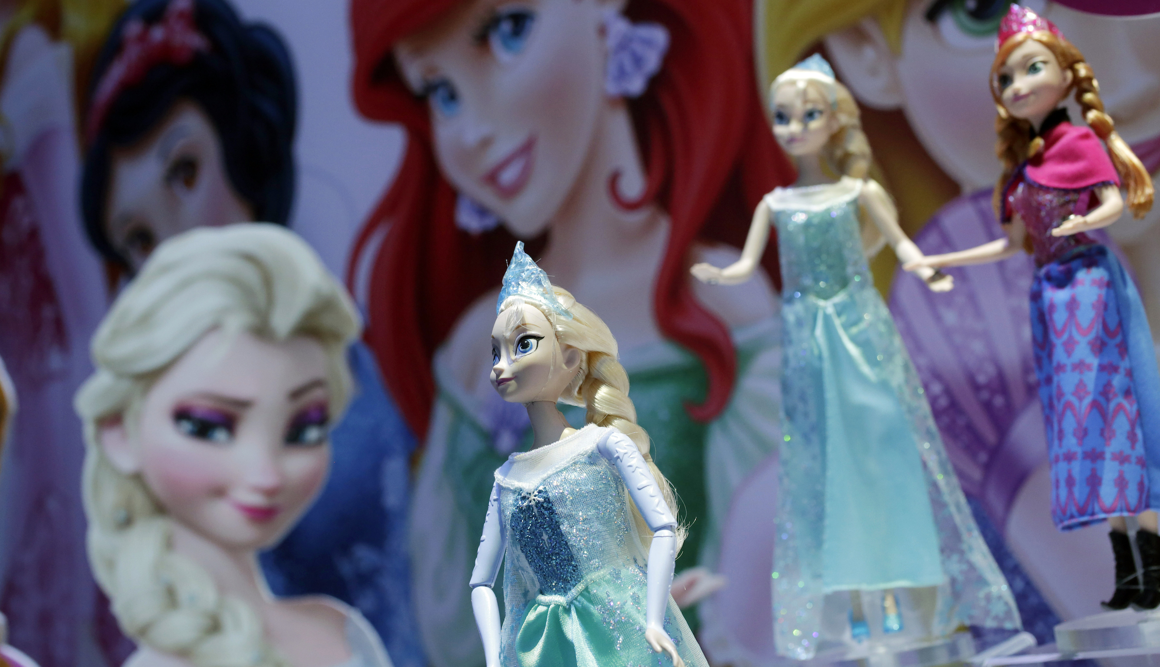 Disney Frozen Feature Fashion Dolls are displayed at the Mattel booth, Friday, Feb. 14, 2014 at the American International Toy Fair in New York. (AP Photo/Mark Lennihan)