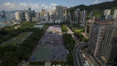 Thousands of pro-Beijing protesters gather to march in the streets to demonstrate against a pro-democracy Occupy Central campaign in Hong Kong August 17, 2014.