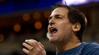Dallas Mavericks team owner Mark Cuban cheers on his team against the Charlotte Bobcats during an NBA basketball game in Charlotte