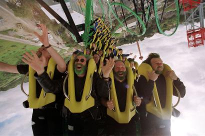 """A group of people ride the """"Riddler's Revenge"""" roller coaster at Magic Mountain amusement park in Va."""