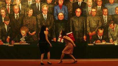 artist Ma Baozhong during the preview of the collection of reunification art at Sotheby's auction in Hong Kong Tuesday, June 26, 2007 to celebrate the 10th Anniversary of Hong Kong handover to China. The painting shows the Sino-British Joint Declaration was signed on Dec. 19, 1984 at the West Hall of the Great Hall in Beijing