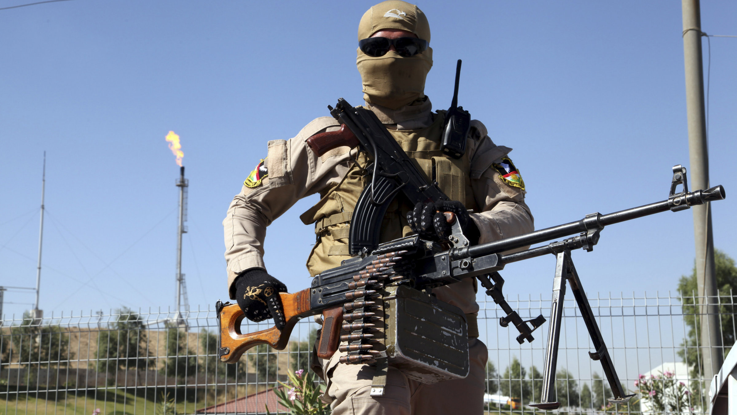 Kurdish peshmerga fighter guarding a refinery outside of Mosul on June 24, 2014.