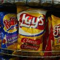 Snack food giant Frito Lay Canada announced February 24, 2004 that it is eliminating trans fat from it's favorite potato chip brands. To remove trans fat, the company will replace hydrogenated oils with corn oil. Frito Lays snacks are seen in a Montreal grocery store, February 24, 2004. REUTERS/Shaun Best SB