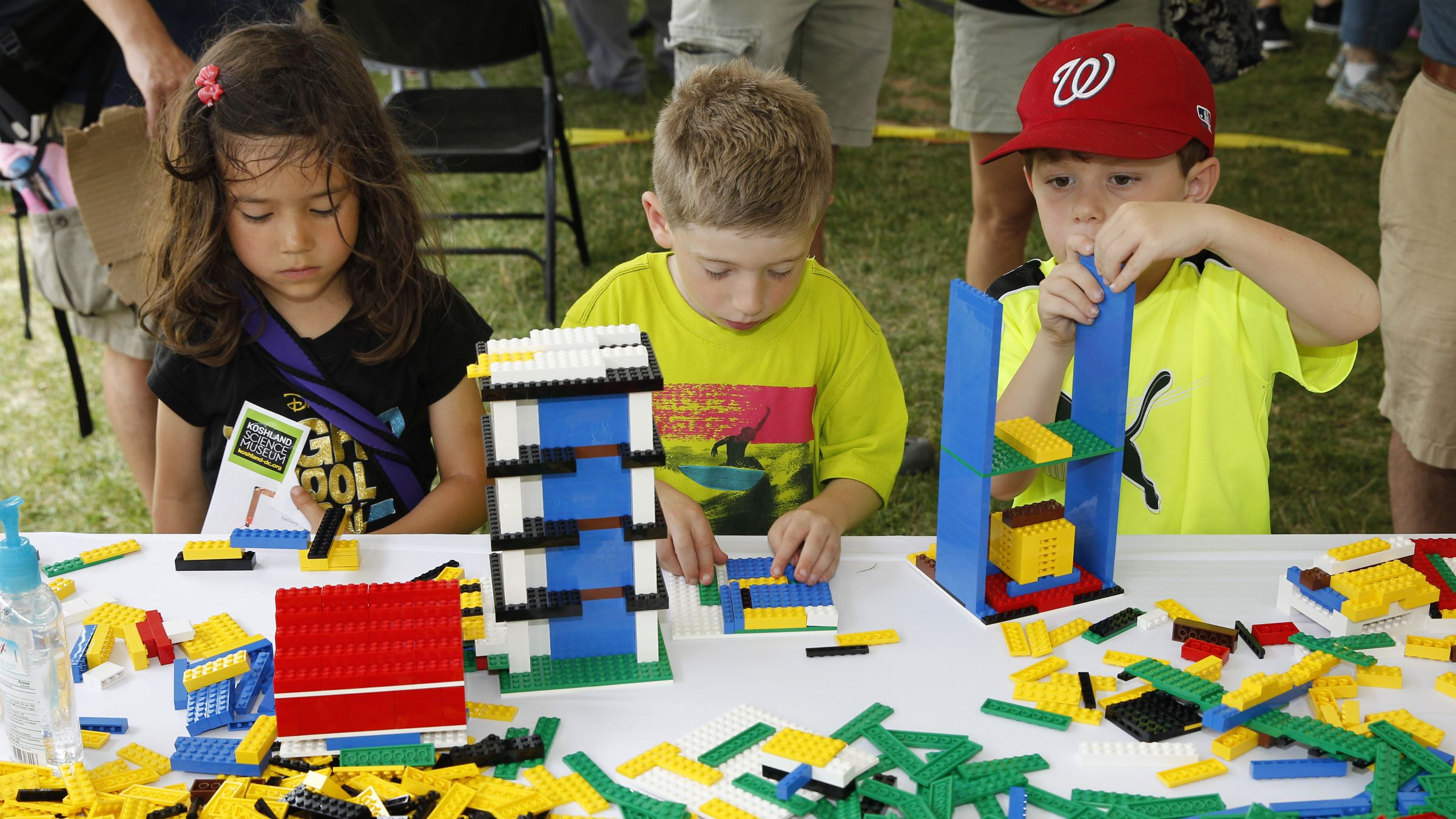 lego research lab stem girls boys gender toys In this photograph released on Wednesday, June 18, 2014, in celebration of National Day of Making, three junior makers showcase LEGO® building skills at first ever DC Mini Maker Faire on Sunday, June 8, 2014 in Washington. (Paul Morigi/AP Images for LEGO